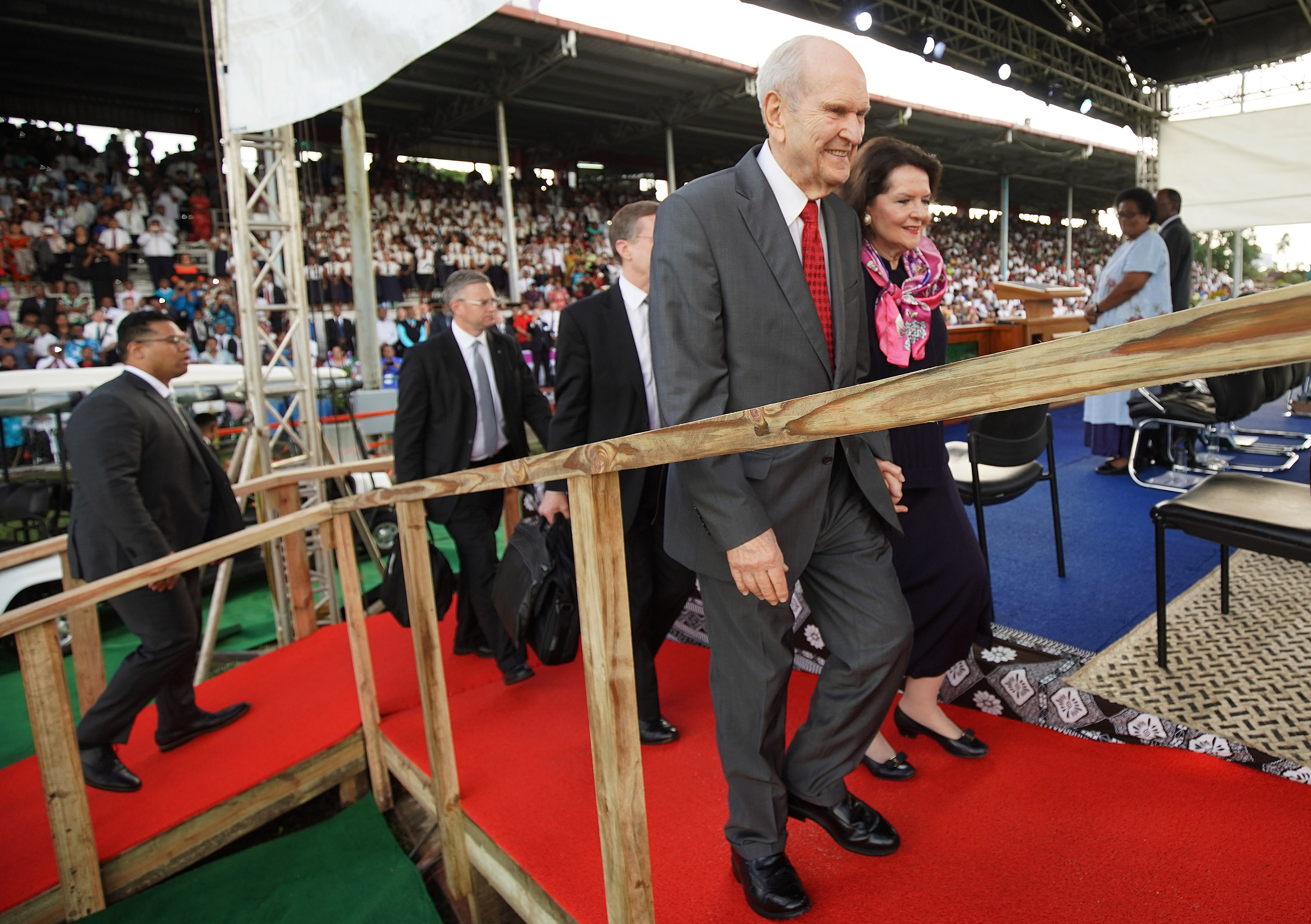 President Russell M. Nelson of The Church of Jesus Christ of Latter-day Saints and his wife Sister Wendy Nelson walk to the stand during a devotional at Ratu Cakobau stadium in Nausori, Fiji on May 22, 2019.