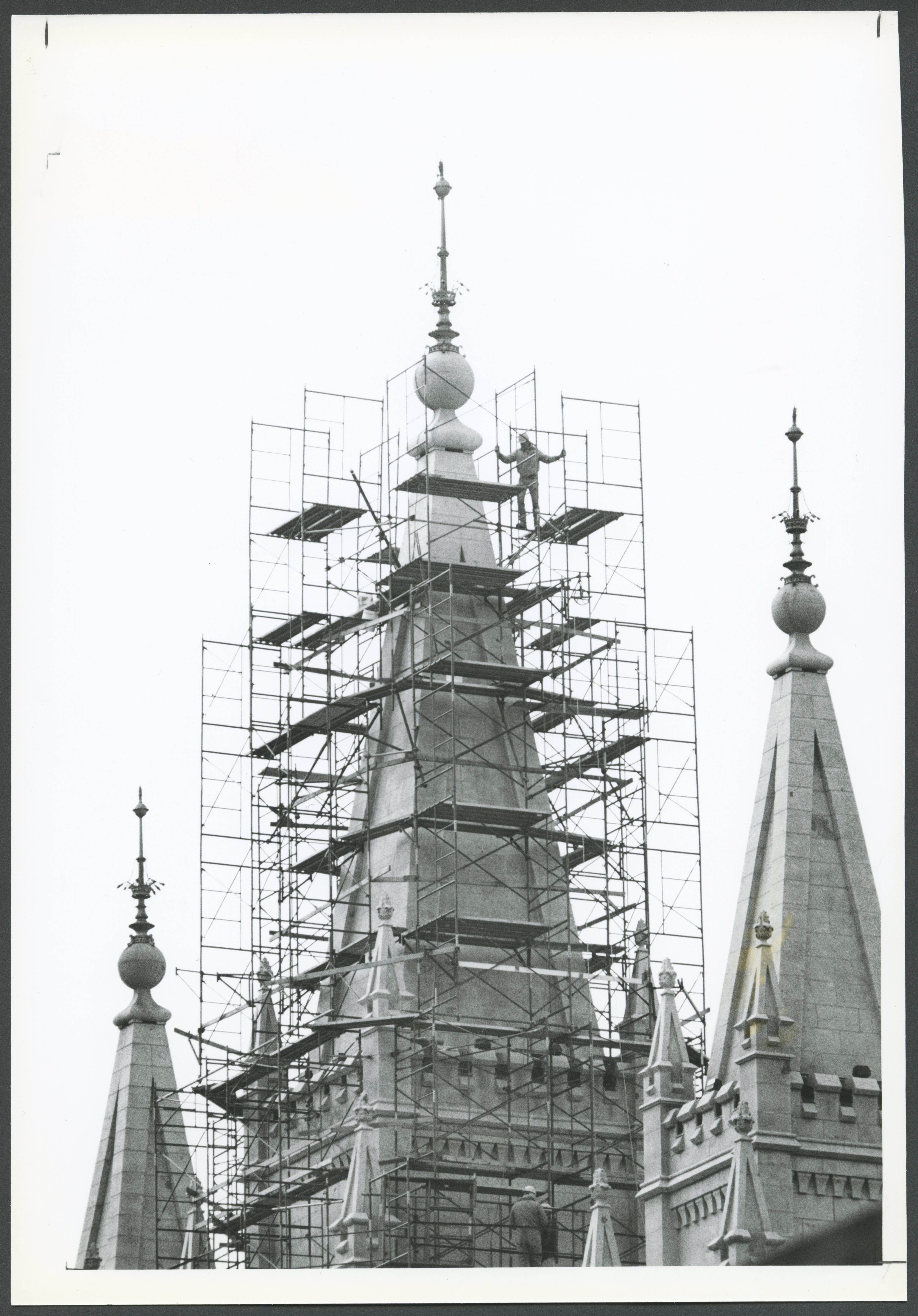 A worker scales the scaffolding of the Salt Lake Temple during its renovation.