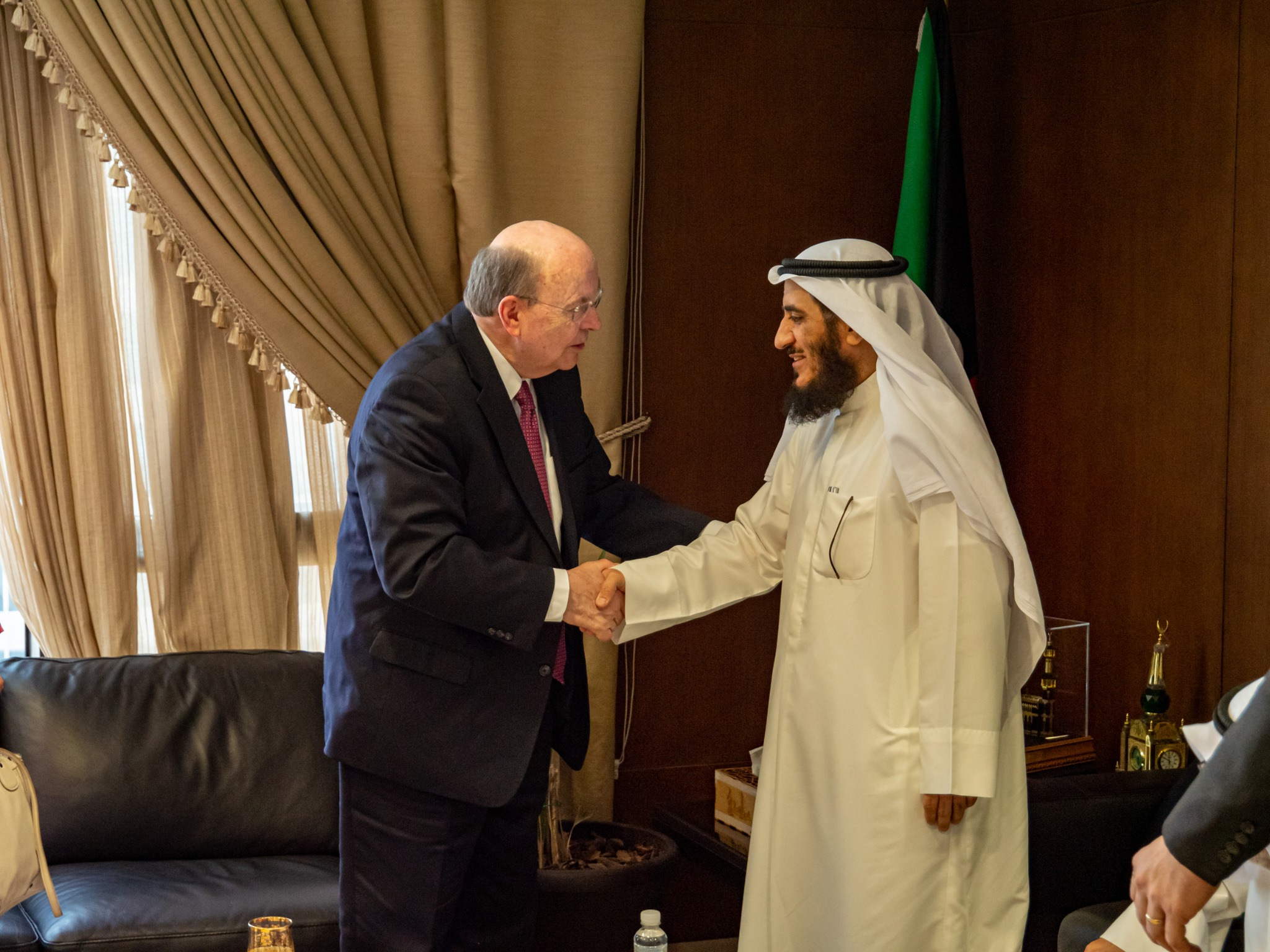 Elder Quentin L. Cook greets Mr. Fareed Emadi, secretary general of the Supreme Commission for the Promotion of Moderation in the Ministry of Awqaf, in Kuwait City on June 10, 2019.
