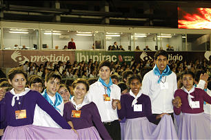 Young men and young women line up to perform traditional Argentine dance during the LDS Argentina cultural celebration. President Henry B. Eying can be seen watching in the background.