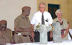 Elder Neil Darlington, center, and Sister Marjorie Darlington, LDS Charities missionaries, talk with W.K. Asieda, director of prisons in Accra, Ghana, during celebration of service project at Borstal Institution, a juvenile facility.