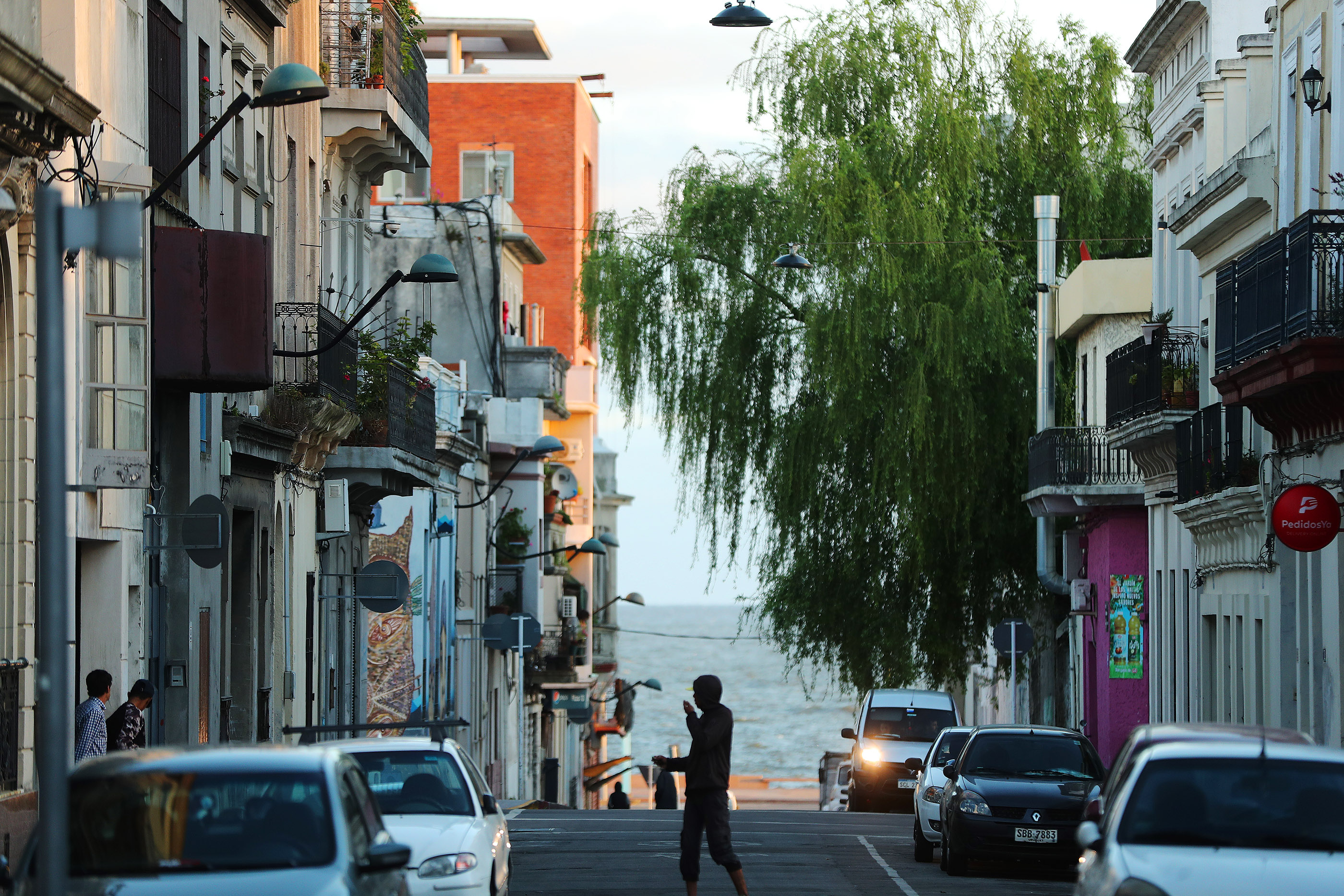 Pedestrians walking the streets in Old Town in Montevideo, Uruguay, on Thursday, Oct. 25, 2018.