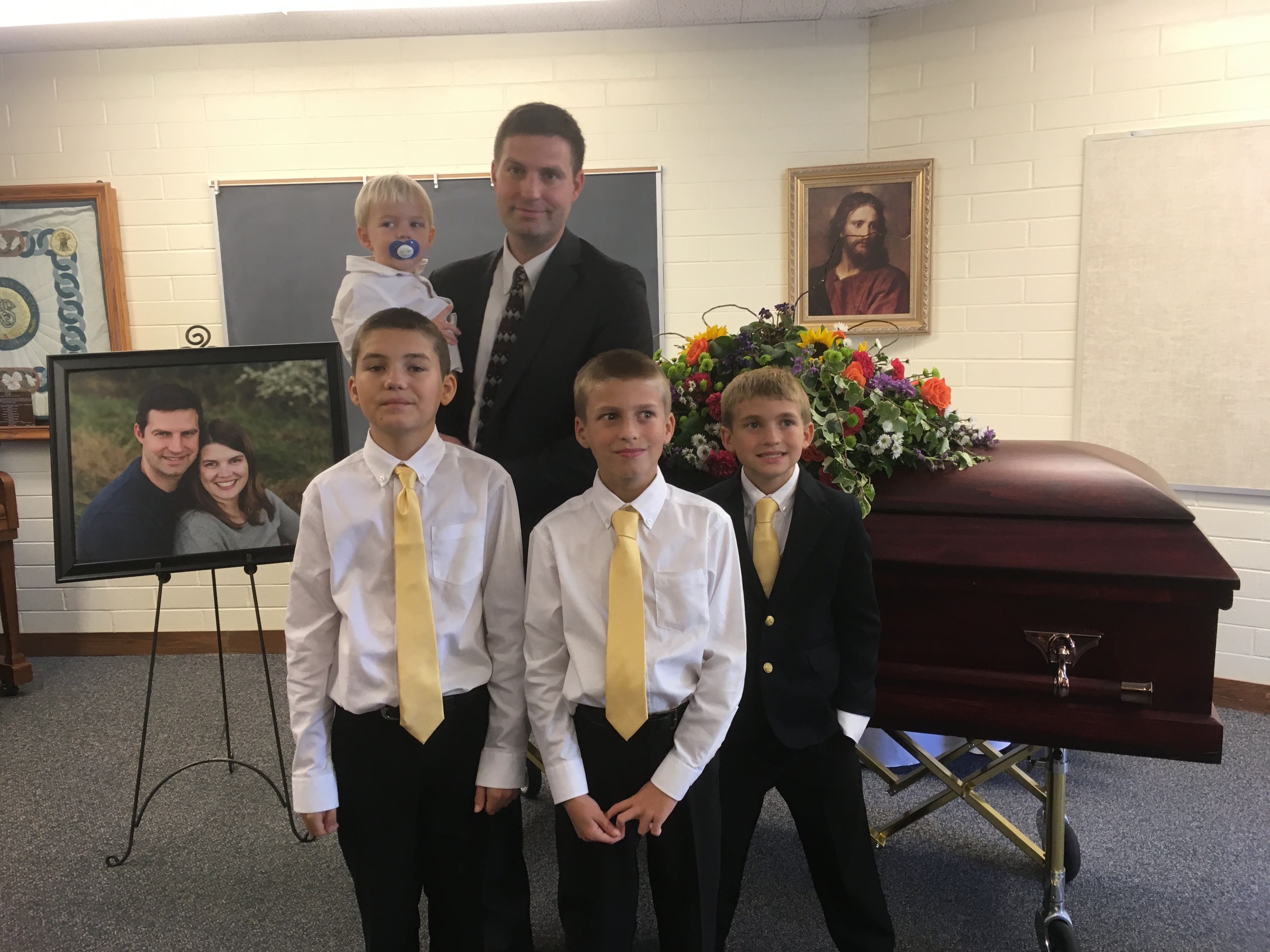 Jacob Evans with his four sons at his wife Katie's funeral.