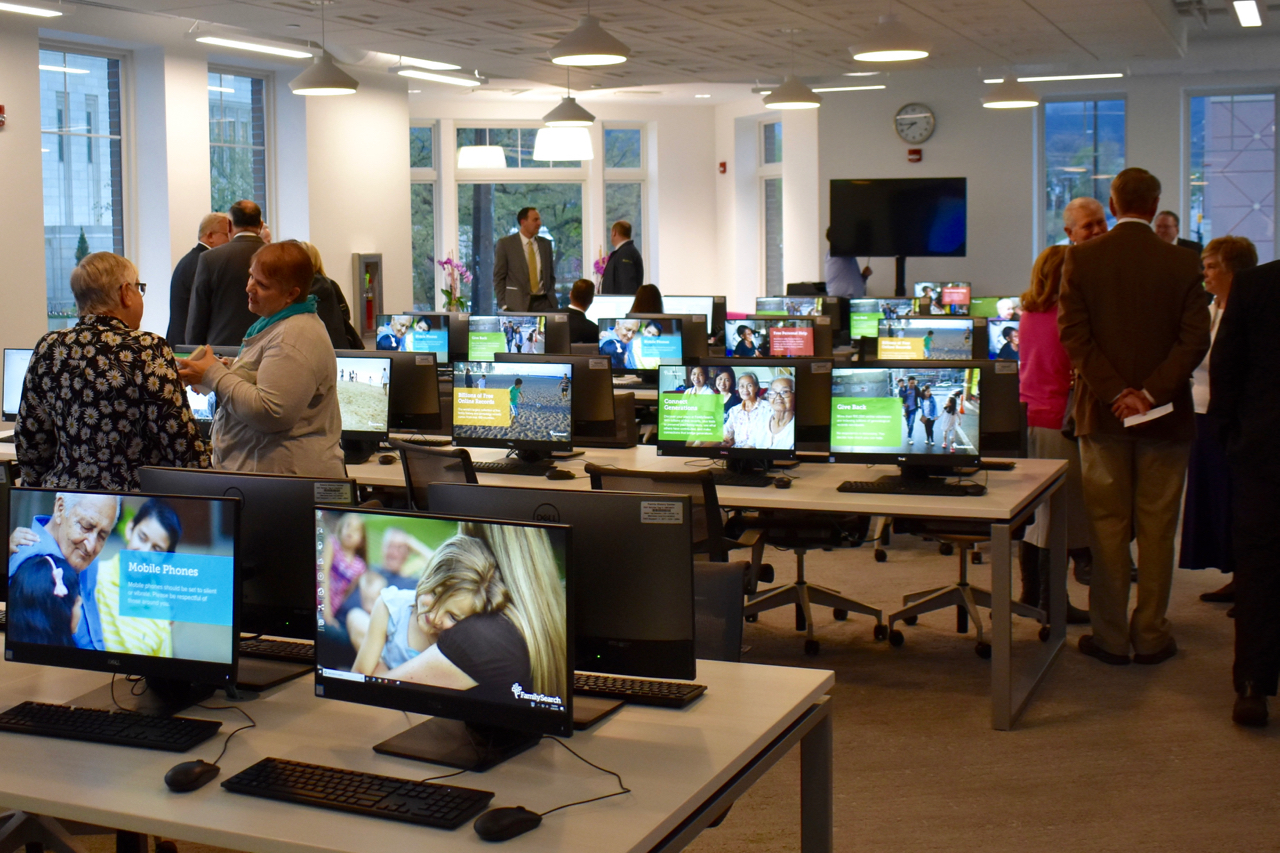 Visitors to the April 30, 2019, dedication services of the new Ogden Utah FamilySearch Center walk through upper-level computer stations. The center has more than 60 desktop computers available for research use.