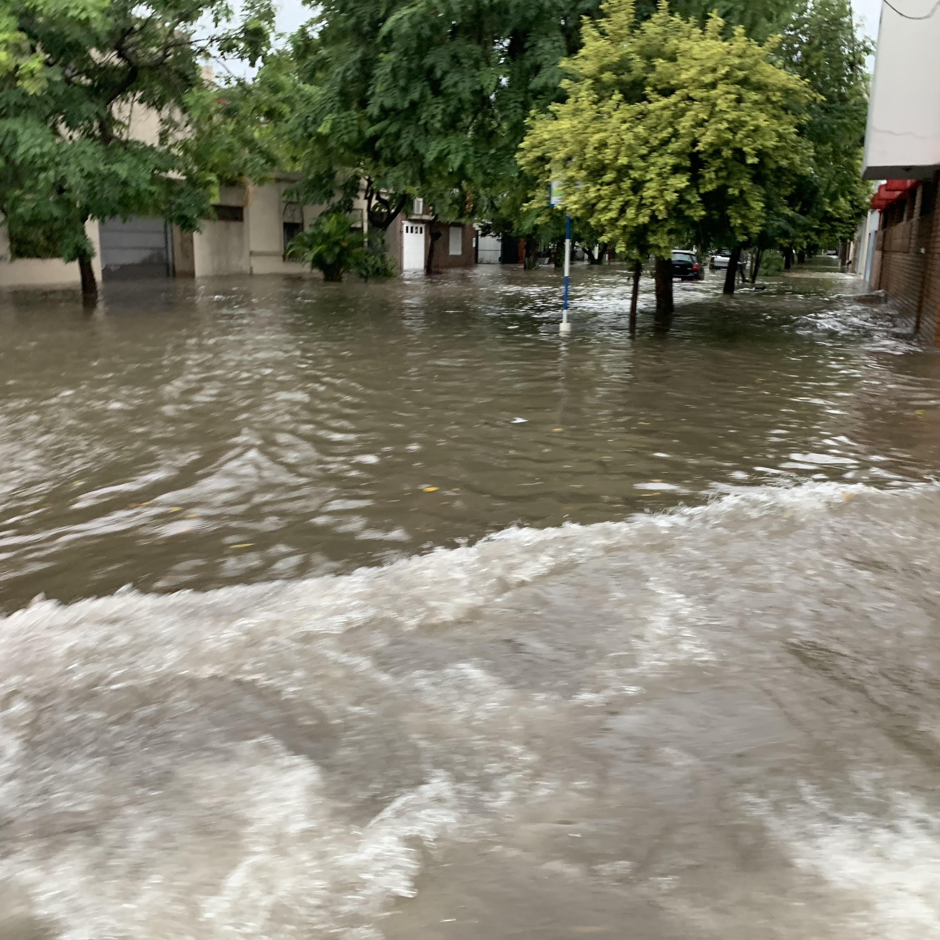 Rains caused flooding in the streets in Resistencia, Argentina, prior to a missionary meeting and stake conference with Elder Neil L. Andersen and Sister Kathy Andersen.
