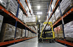 A worker moves food at the new 570,000 square foot Utah Bishops' Central Storehouse in Salt Lake City, Thursday, Jan. 26, 2012.