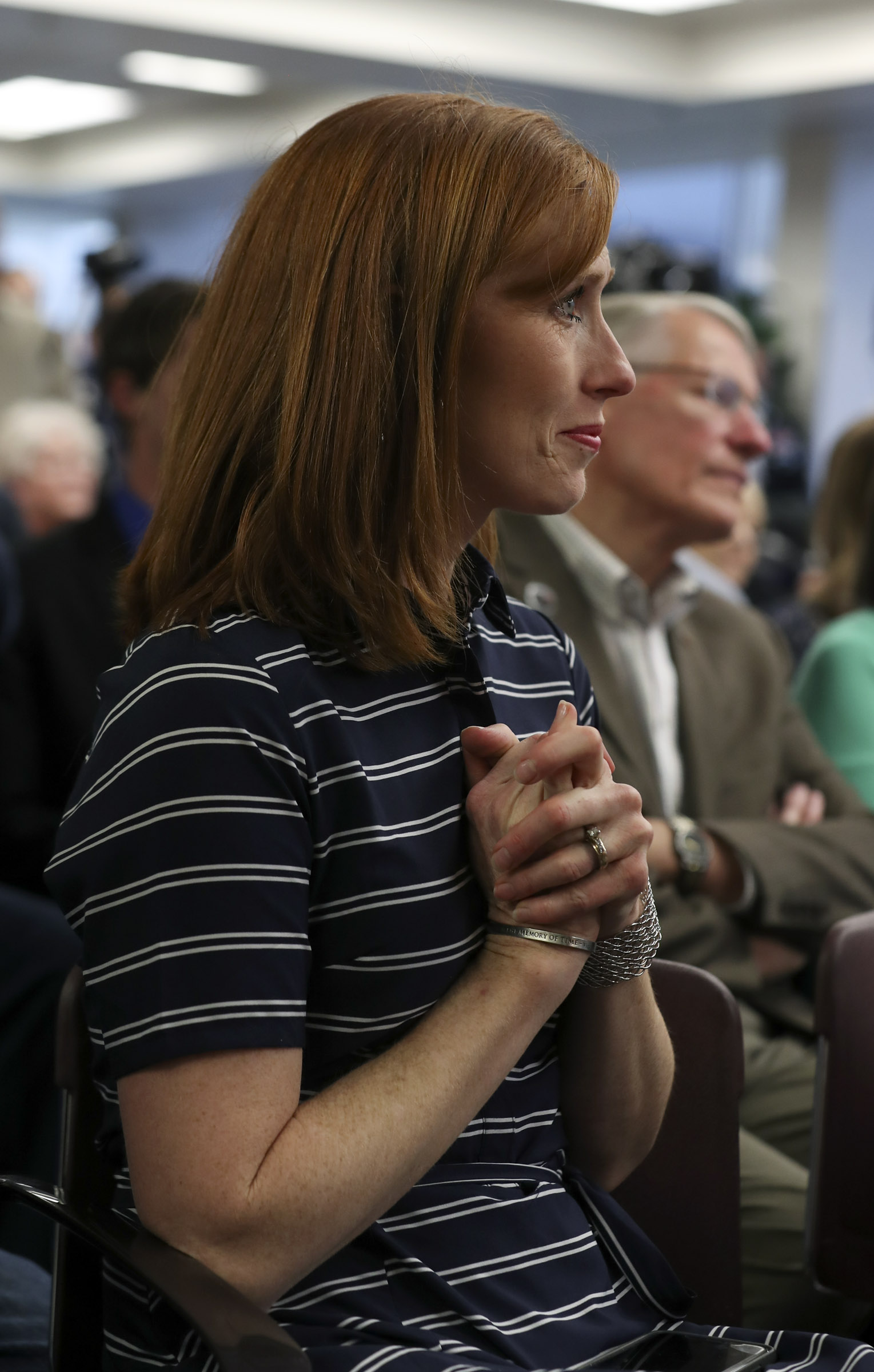 Jennie Taylor listens to a song during a ceremony where the name of her husband, Maj. Brent Taylor, who was killed in Afghanistan in 2018, was added to the Reflection Room Memorial Wall in the Wilkinson Center on the BYU campus in Provo on Thursday, May 23, 2019.