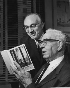 "President Joseph Fielding Smith, right, and Elder Gordon B. Hinckley look at at copy of Elder Hinckley's book ""Truth Restored."""