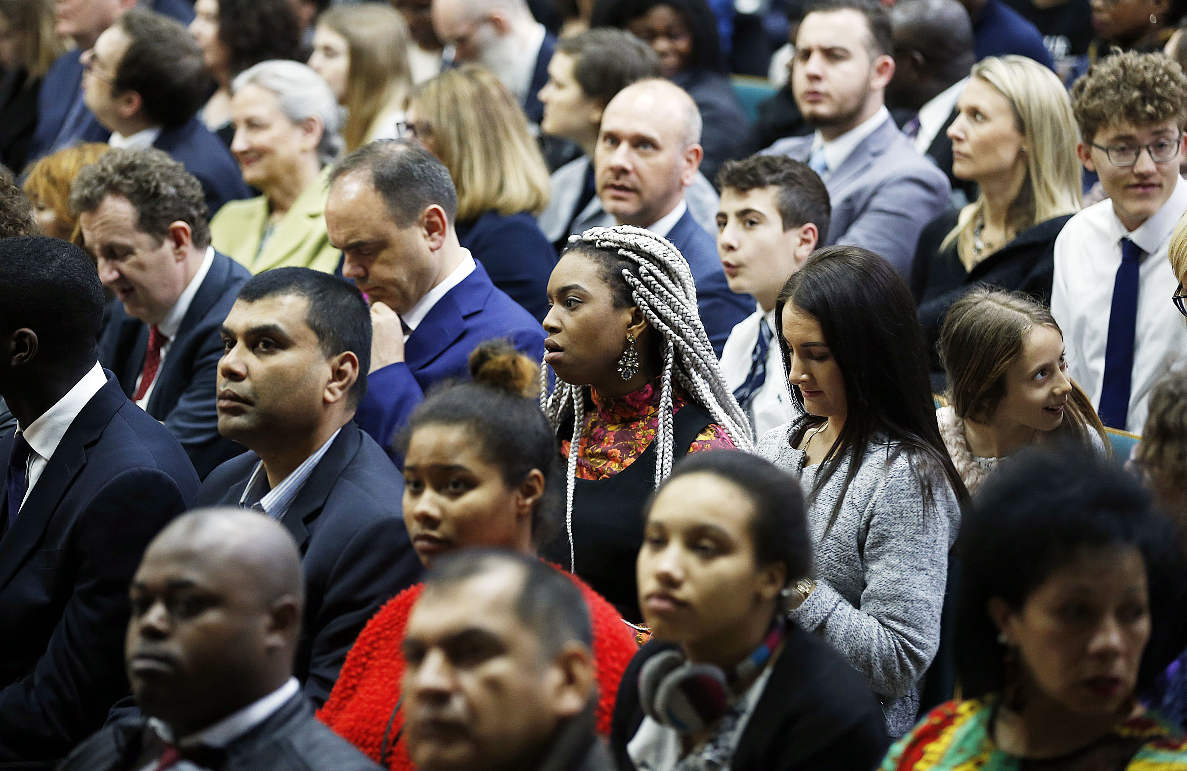 Those in attendance wait for the start of a meeting with President Russell M. Nelson at the Hyde Park Chapel in London on Thursday, April 12, 2018.