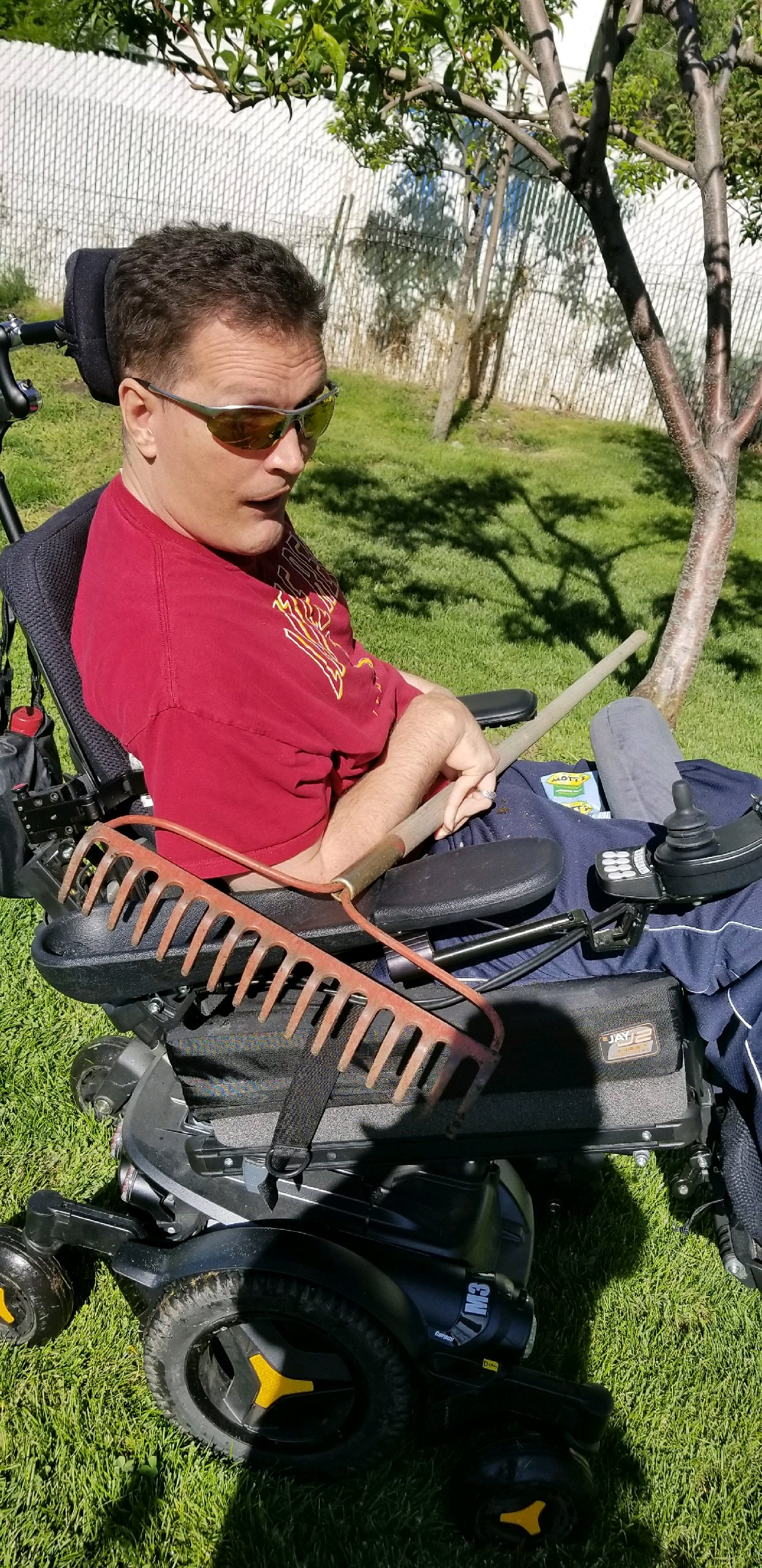 Orin Voorheis takes a rake to work in the garden. More than 20 years after being shot in the head on his mission, Voorheis is living a happy life surrounded by family and friends.