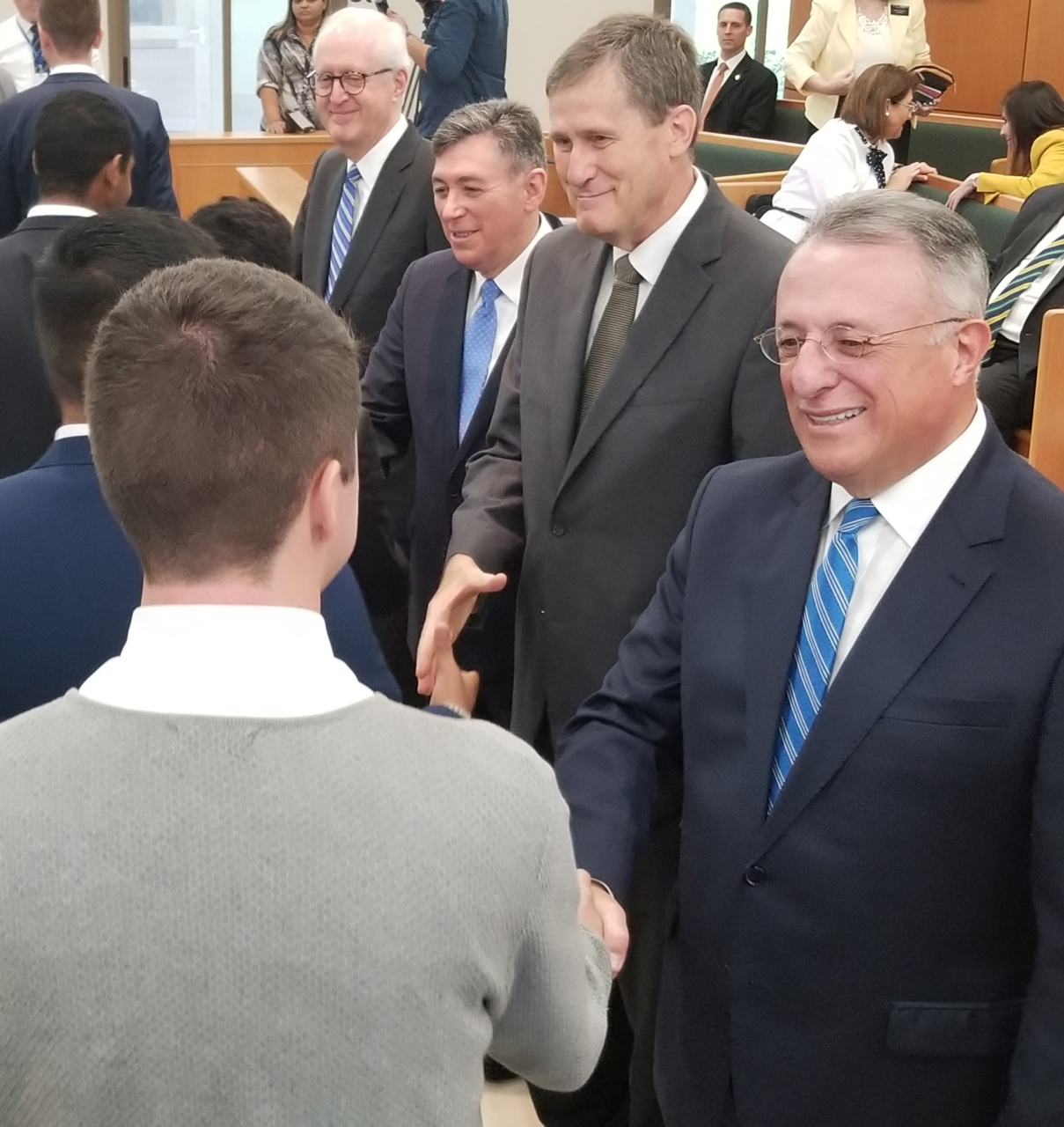 Elder Ulisses Soares of the Quorum of the Twelve Apostles greets a missionary before a meeting with the Brazil Fortaleza and Brazil Fortaleza East missions on Saturday, June 1, 2019. Joining Elder Soares are three General Authority Seventies — starting from his side, Elder Marcos A. Aidukaitis, Elder Adilson de Paula Parrella and Elder Larry Y. Wilson.