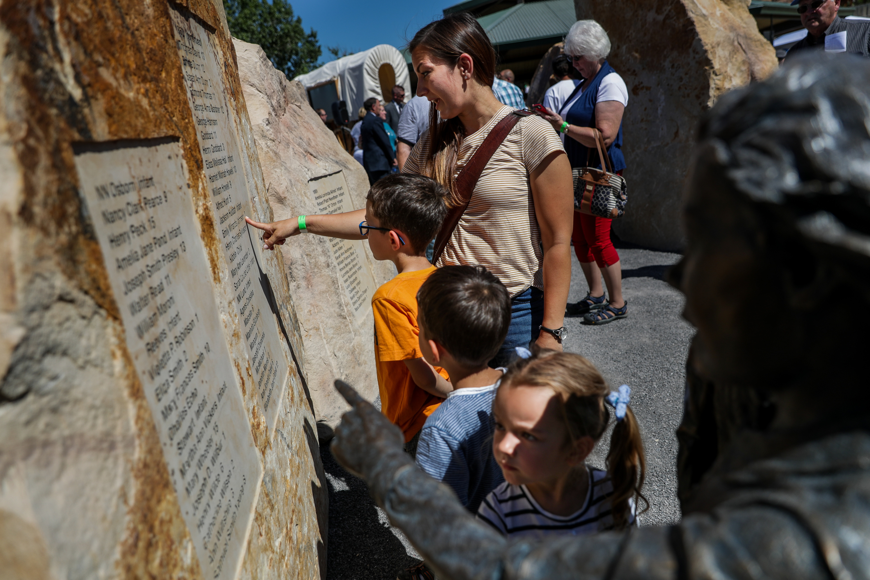 Elisabeth Farnsworth and her children — Sam, 7, Noah, 5, and Hannah, 3 — who are visiting from Gorlitz, Germany, tour the Children's Pioneer Memorial at This Is the Place Heritage Park in Salt Lake City after its dedication on Saturday, July 20, 2019.