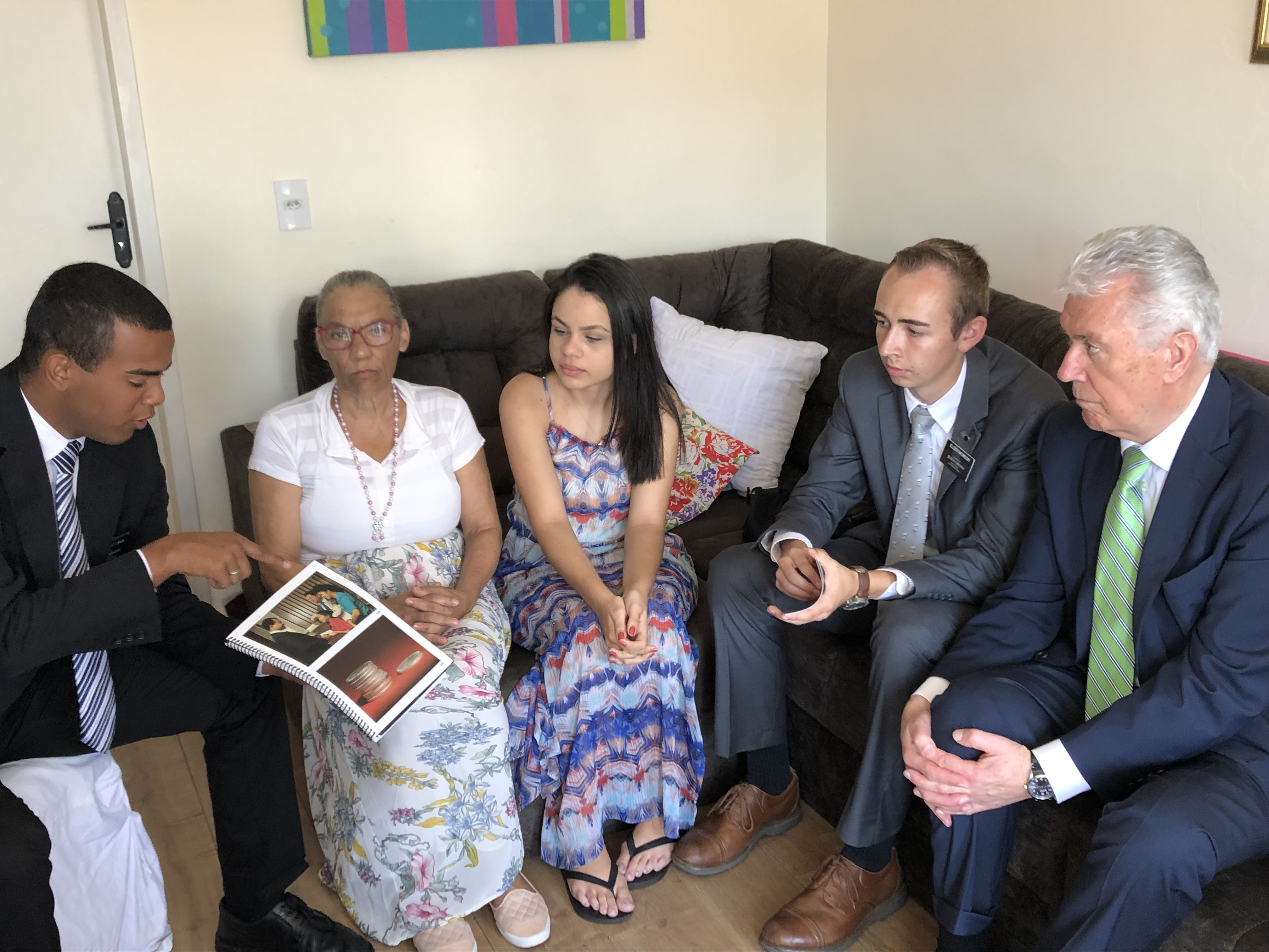 Elders Herick David Sousa Ventura and Robert David Monson of the Brazil Sao Paulo West Mission are joined by Elder Dieter F. Uchtdorf of the Quorum of the Twelve Apostles as they teach a grandmother and her two teenage daughters in February 2019.