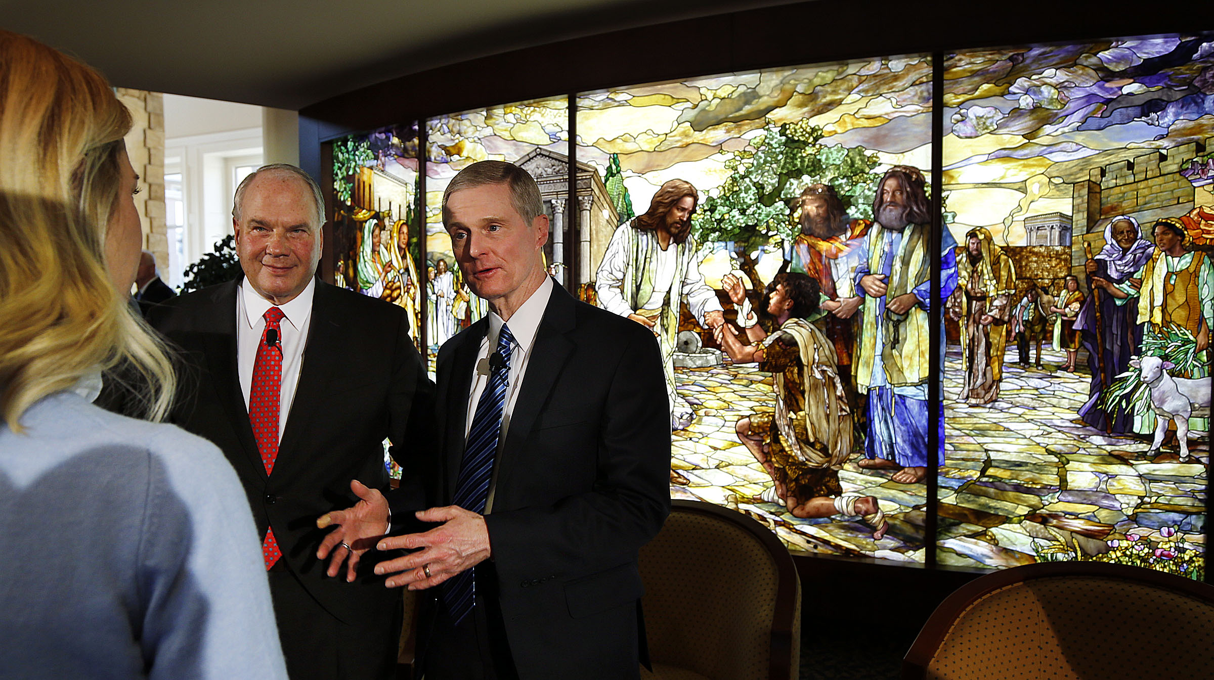 Elder Ronald A. Rasband, left, and Elder David A. Bednar of the Quorum of the Twelve Apostles talk with CNN correspondent Delia Gallagher following a press conference in the Rome Temple Visitor's Center of The Church of Jesus Christ of Latter-day Saints on Monday, Jan. 14, 2019.