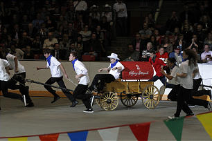 A chuckwagon race is part of the Calgary Stampede segment. Young men pulled wagons and outriders on stick horses galloped alongside.