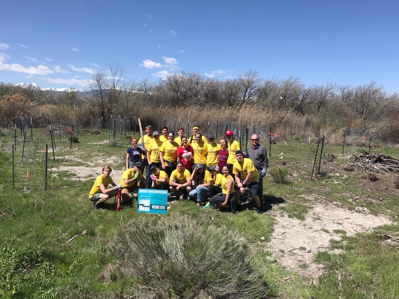 Volunteers from Salt Lake area young single adult stakes installed fences around newly planted trees on the Jordan River Parkway.