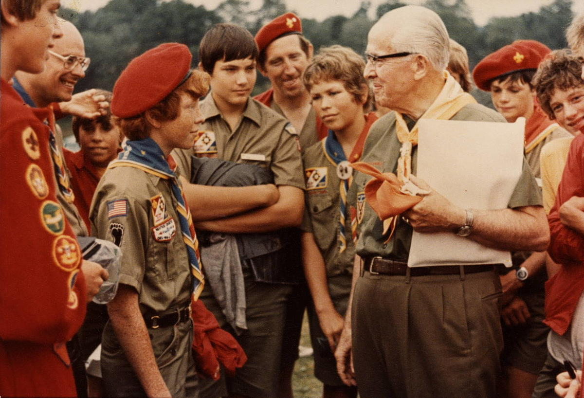 President Ezra Taft Benson is photographed with Boy Scouts at 1977 National Scout Jamboree.