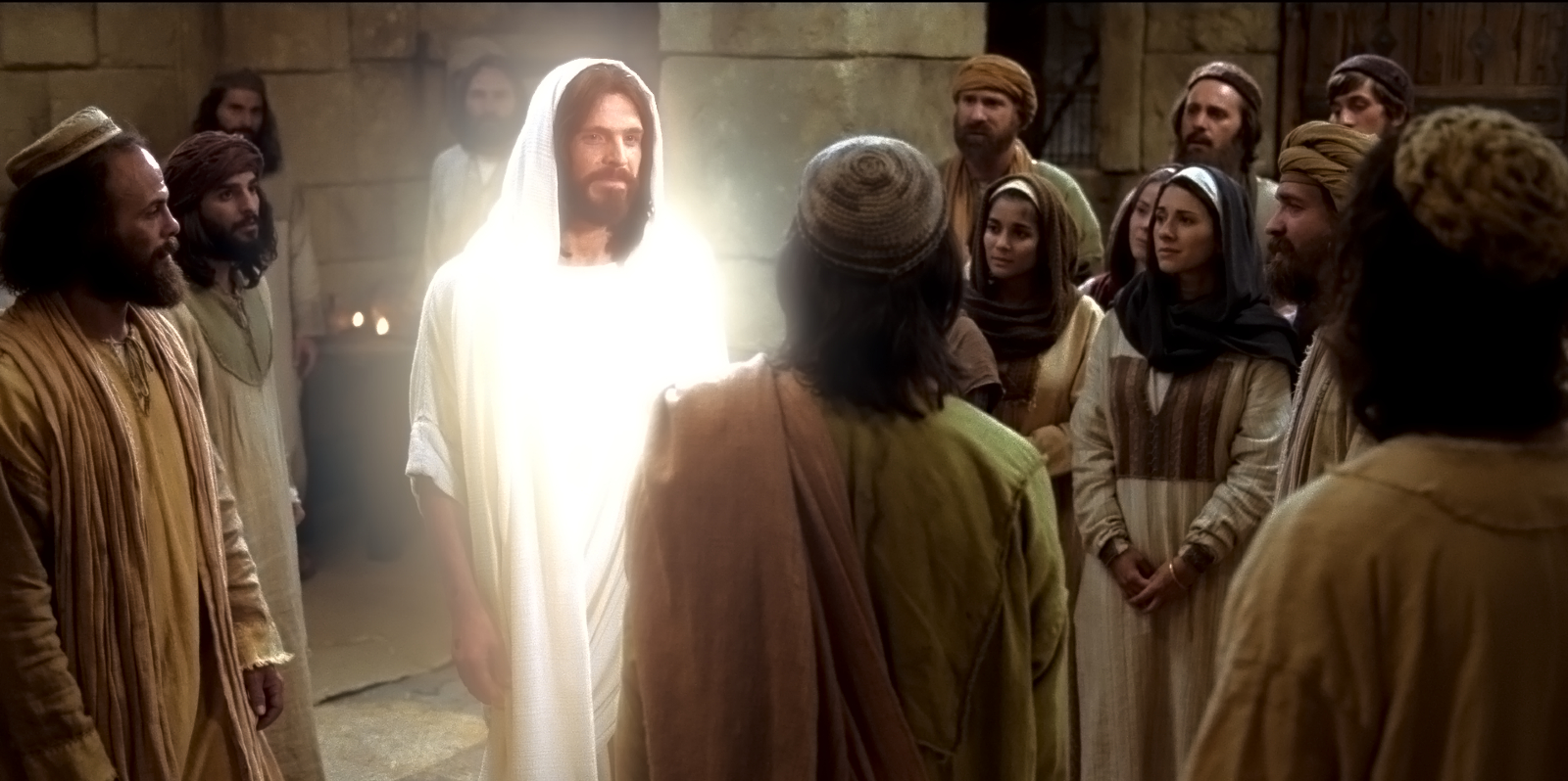 Jesus Christ, now resurrected, approaches his apostles and others in this scene from a Bible Video.