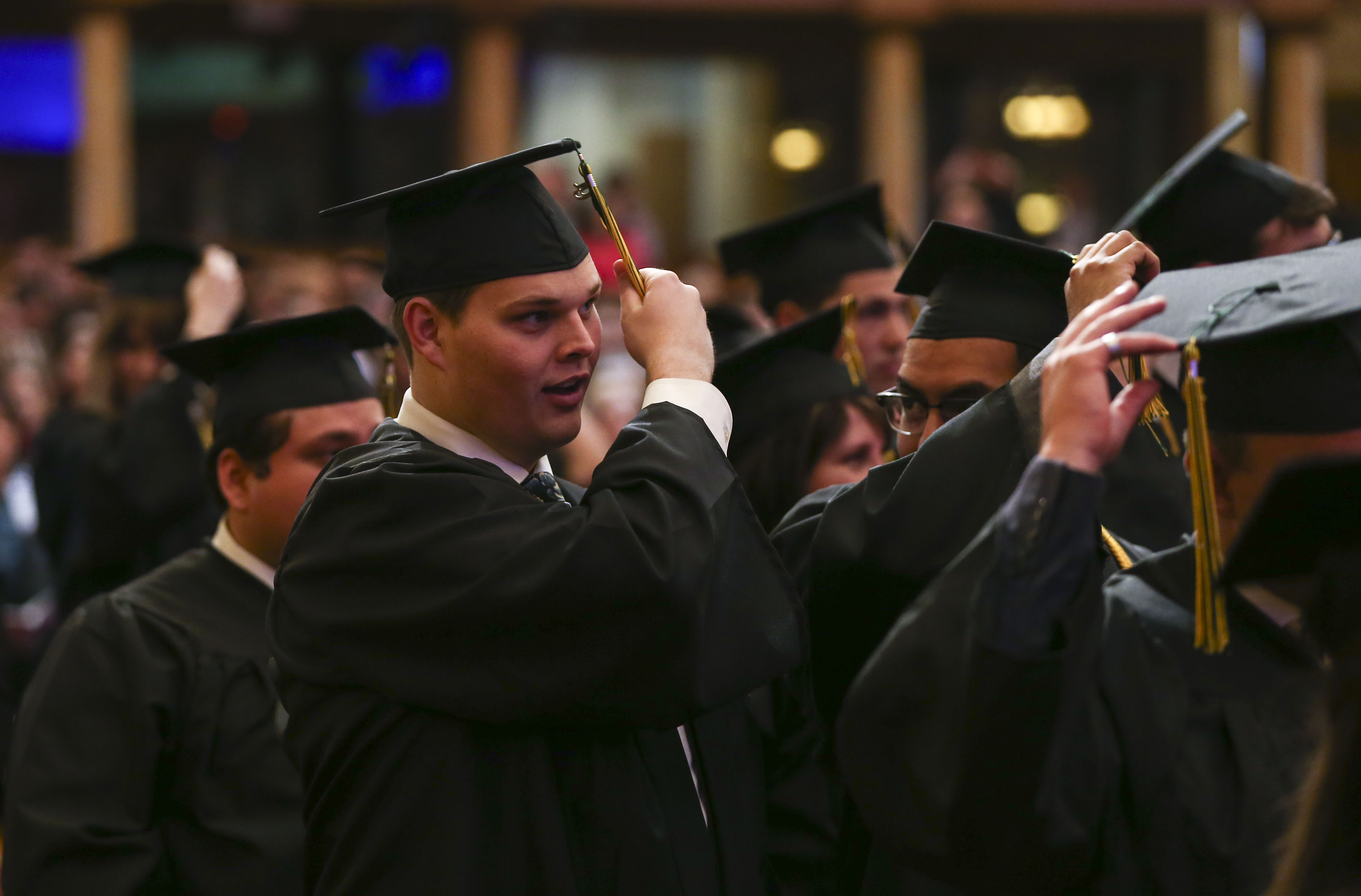 Joseph Justice moves his tassel from the right side to the left during the commencement ceremony for LDS Business College at the Tabernacle on Temple Square in Salt Lake City on Friday, April 12, 2019.