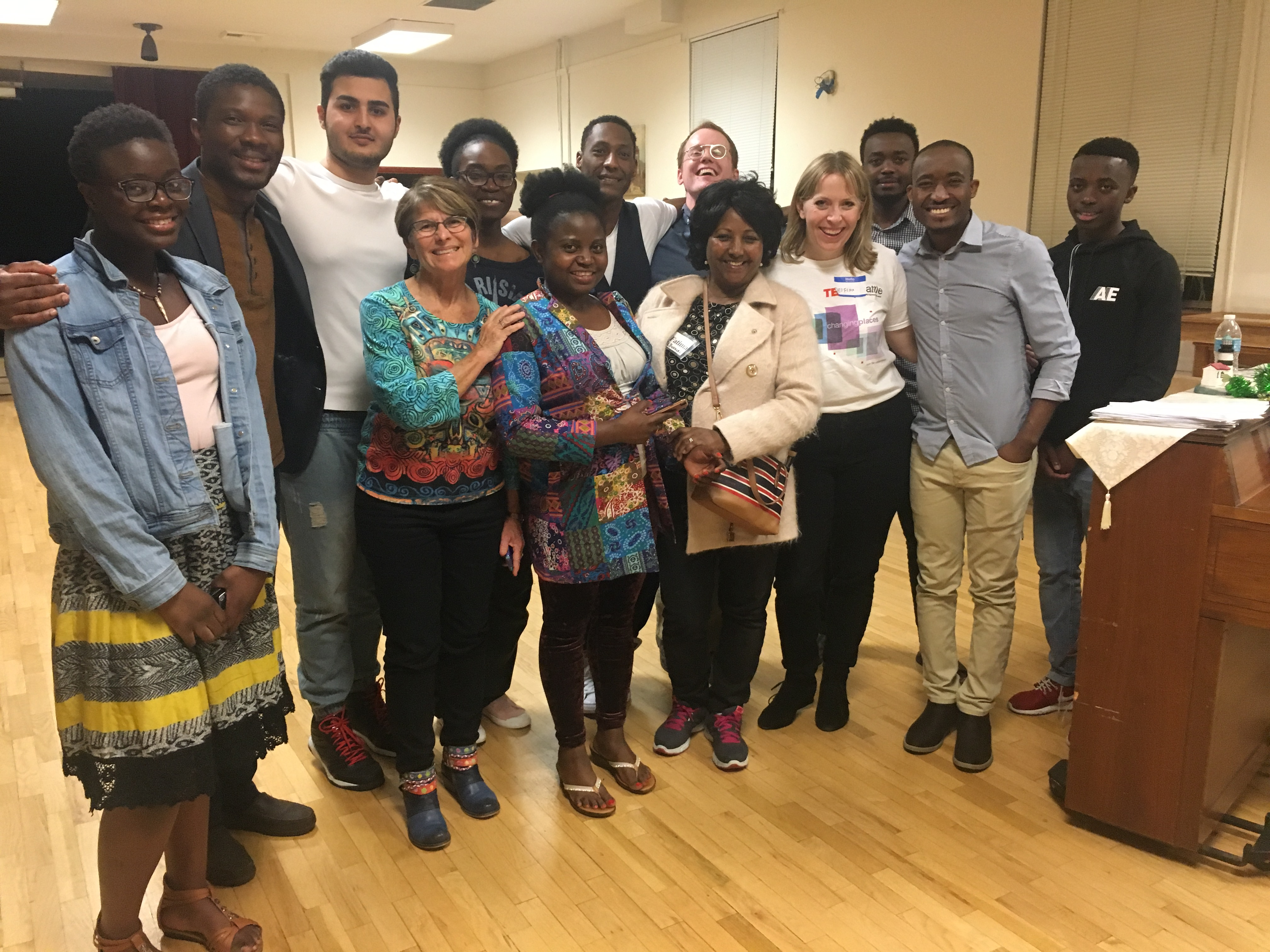 Tacoma Refugee Choir participants pose for a photo following a rehearsal.