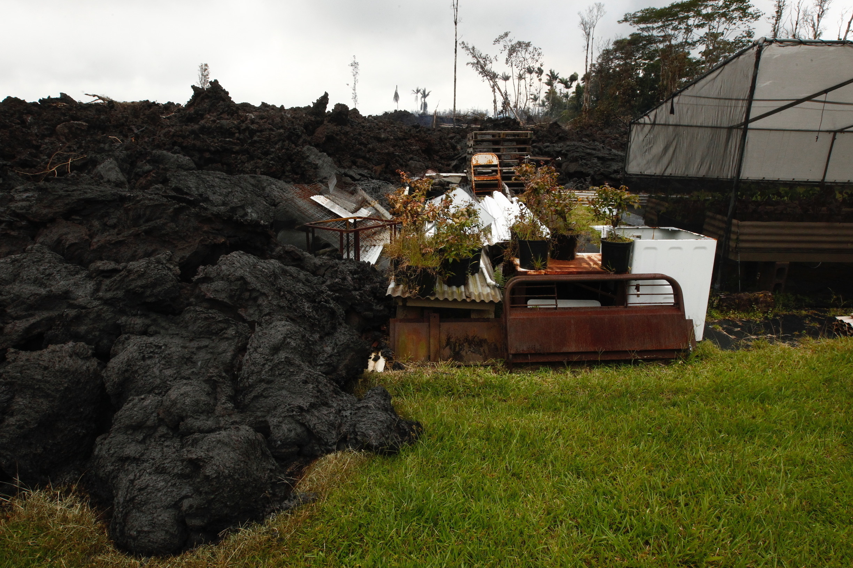 Lava overruns property along Hookupu Street, Monday, May 7, 2018, in Pahoa, Hawaii. Hawaii's Kilauea volcano destroyed homes and spewed lava hundreds of feet into the air.