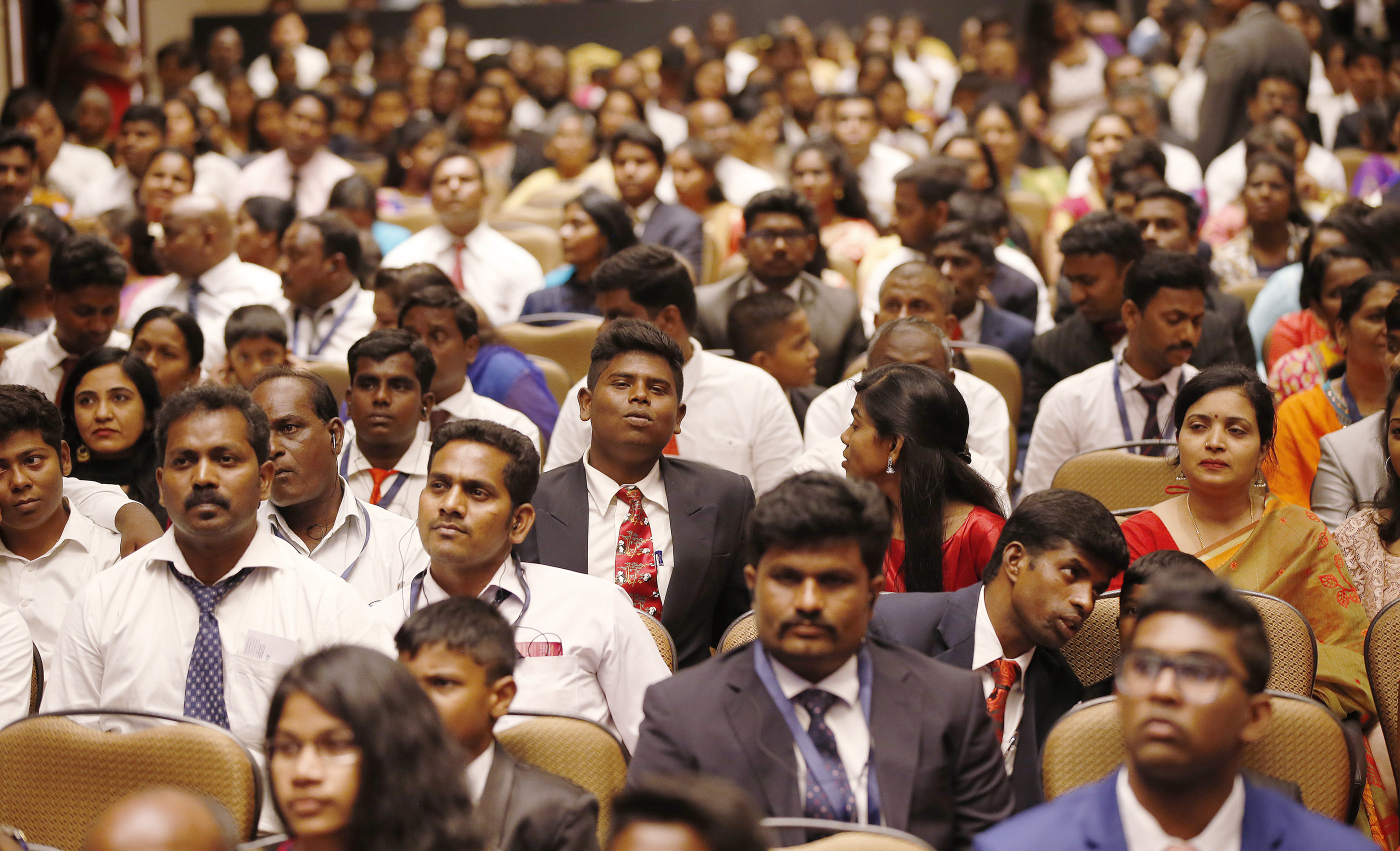 Attendees listen during a devotional with President Russell M. Nelson in Bengaluru, India, on Thursday, April 19, 2018.