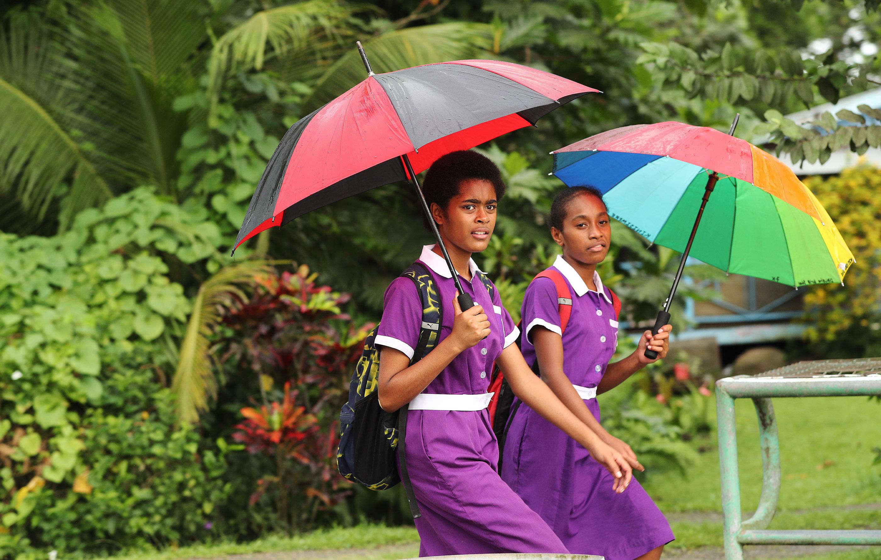 School girls walk home in Nausori, Fiji on May 22, 2019.