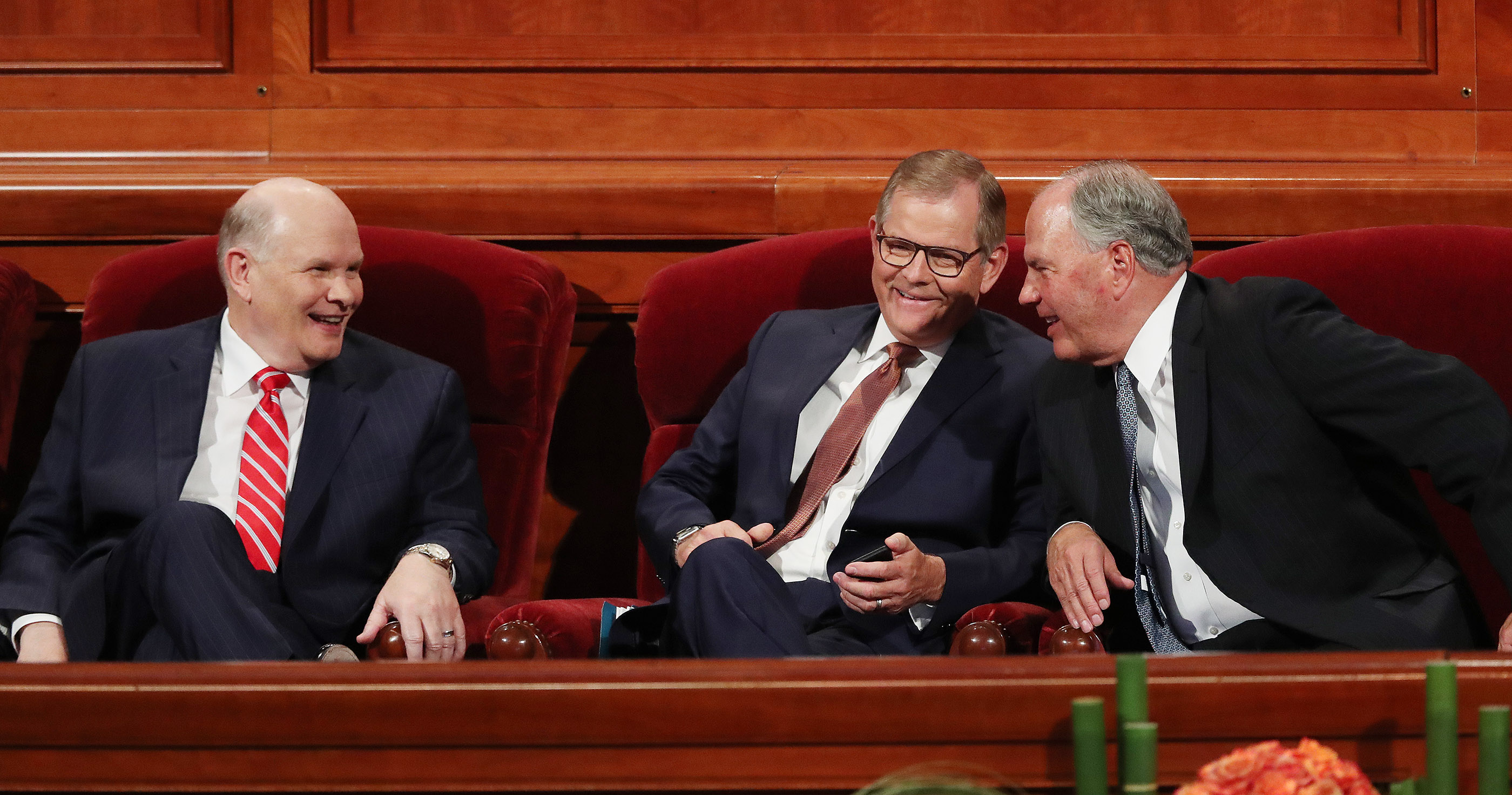Elder Dale G. Renlund, left, Elder Gary E. Stevenson and Elder Ronald A. Rasband of the Quorum of the Twelve Apostles talk prior to the Sunday afternoon session of the 188th Semiannual General Conference of The Church of Jesus Christ of Latter-day Saints in the Conference Center in Salt Lake City on Sunday, Oct. 7, 2018.