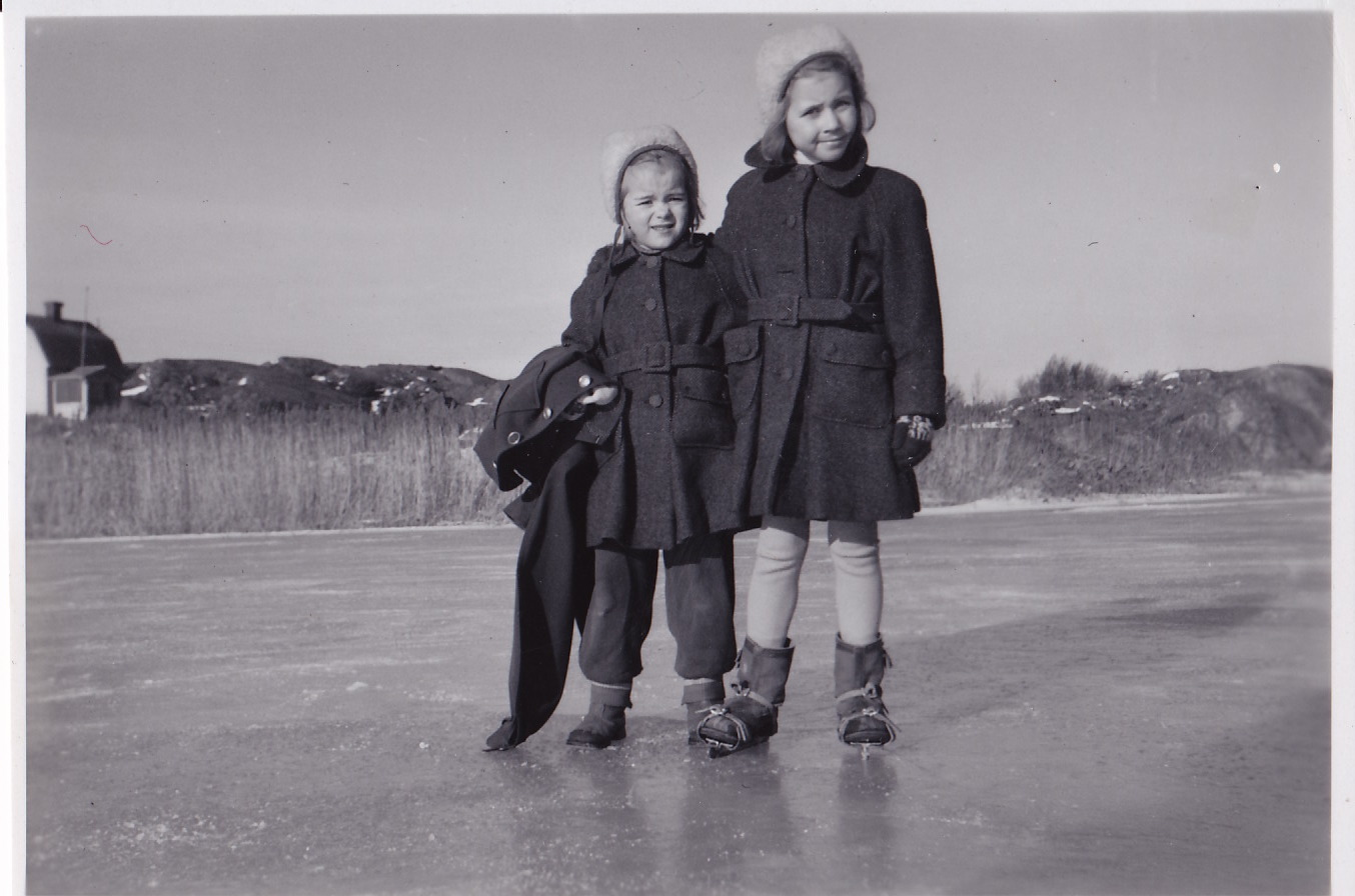 Lisbeth Pettersson with her younger sister Ann-Marie ice skating at a pond near their home in Sweden in 1950.