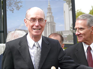 President Henry B. Eyring, who presided at the groundbreaking ceremony, stands before an architectural rendering of the historic and classical-style temple, which will stand in Logan Square near Philadelphia's stately library and courthouse. Elder Jay E. Jensen from the presidency of the Seventy is at his right.
