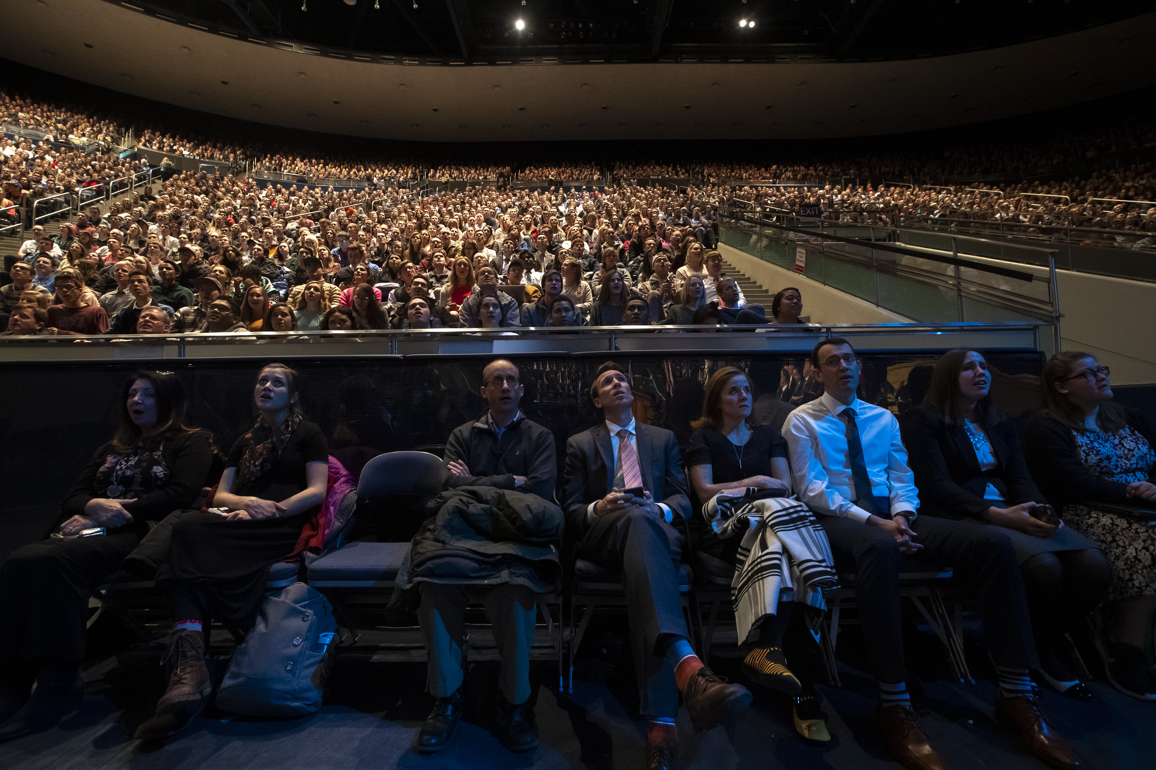 Audience members sing a closing hymn after listening to Elder David A. Bednar of the Quorum of the Twelve Apostles of The Church of Jesus Christ of Latter-day Saints speak at the campus devotional in the Marriott Center at BYU in Provo on Tuesday, Dec. 4, 2018.