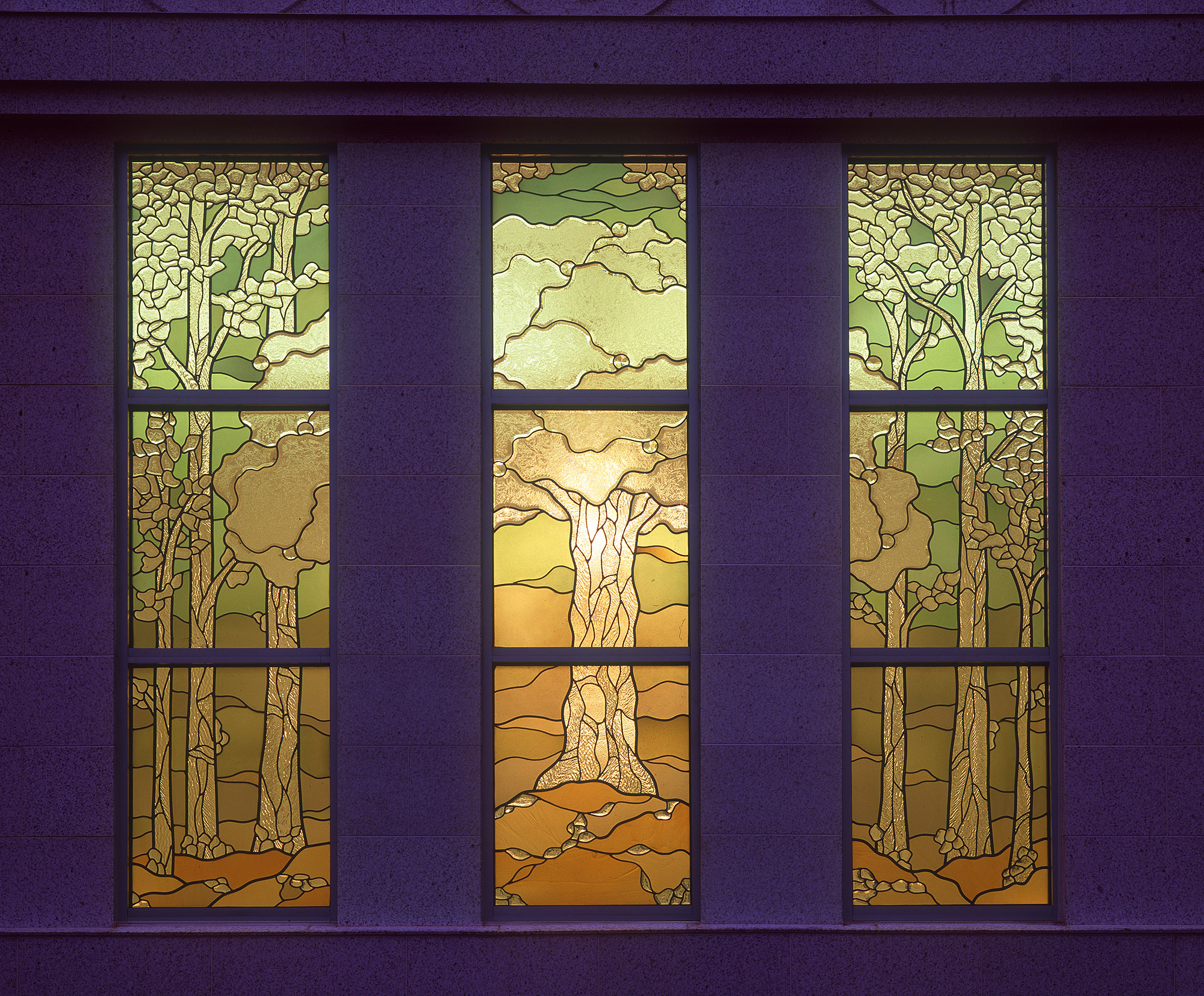 The window of the celestial room at the Palmyra New York Temple from outside the temple. This custom window features an interpretation of the tree of life.