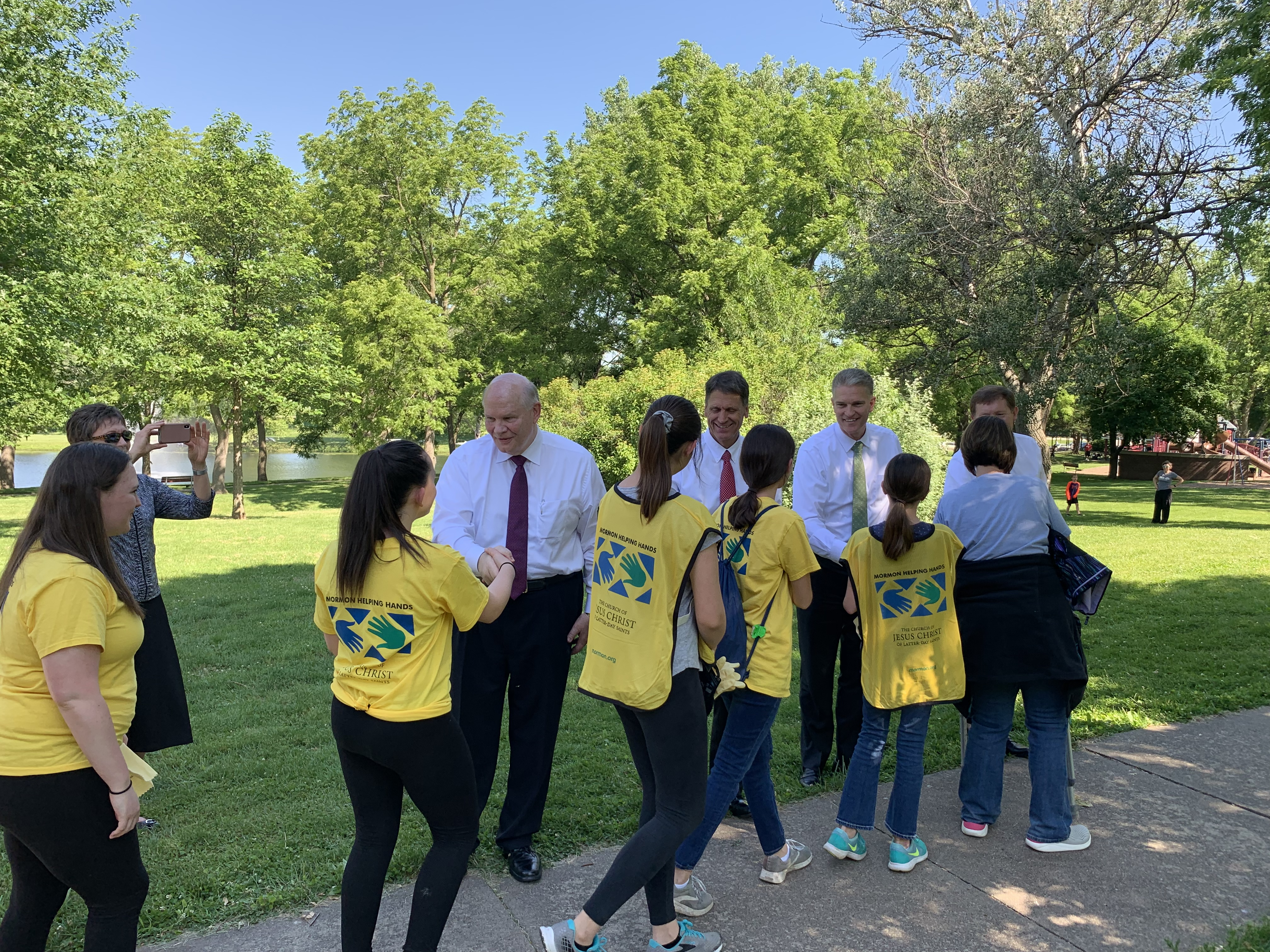 Elder Dale G. Renlund greets youth and leaders who came to serve the Iowa flood victims on June 10, 2019.