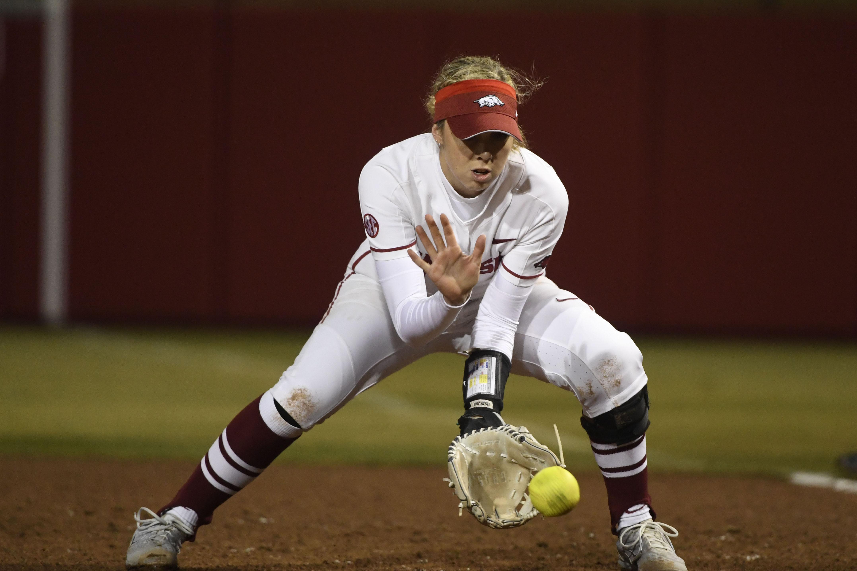 Arkansas first baseman Danielle Gibson fields a ground ball against SEMO during an NCAA softball game on Friday Feb. 22, 2019, in Fayetteville, Arkansas.