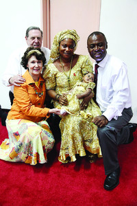 Elder and Sister Holland visit Freetown Sierra Leone District President Patrick Jnr Swarray and his wife, Sebapu, and daughter, Patricia.