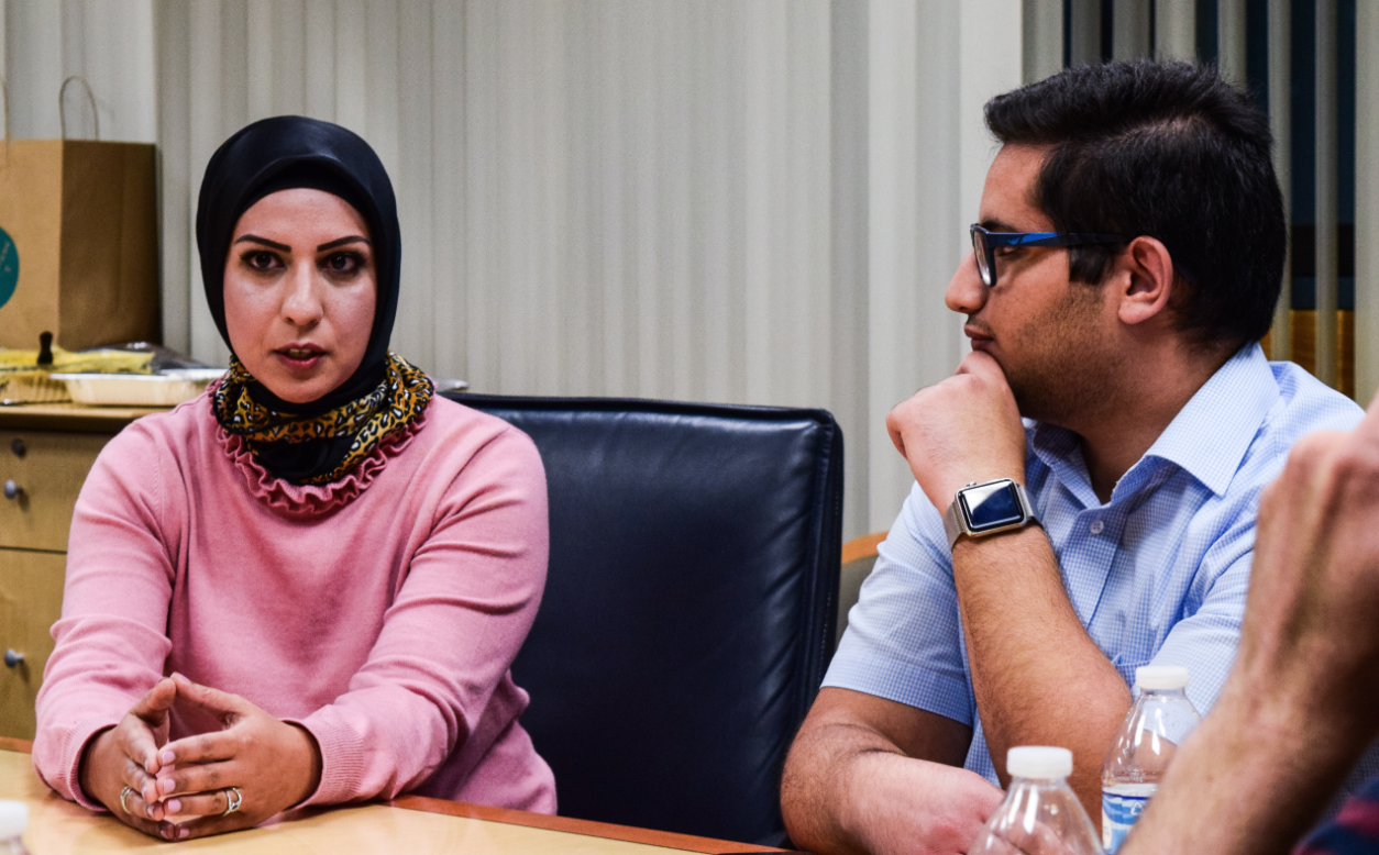 Barrister Raffia Arshad, left, speaks with BYU junior Laith Habahbeh, among others, at an event held by the BYU Interfaith Club on Oct. 16, 2018.