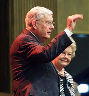 Elder M. Russell Ballard waves to attendees with wife, Sister Barbara Ballard, prior to speaking to Davis County Young Single Adults.