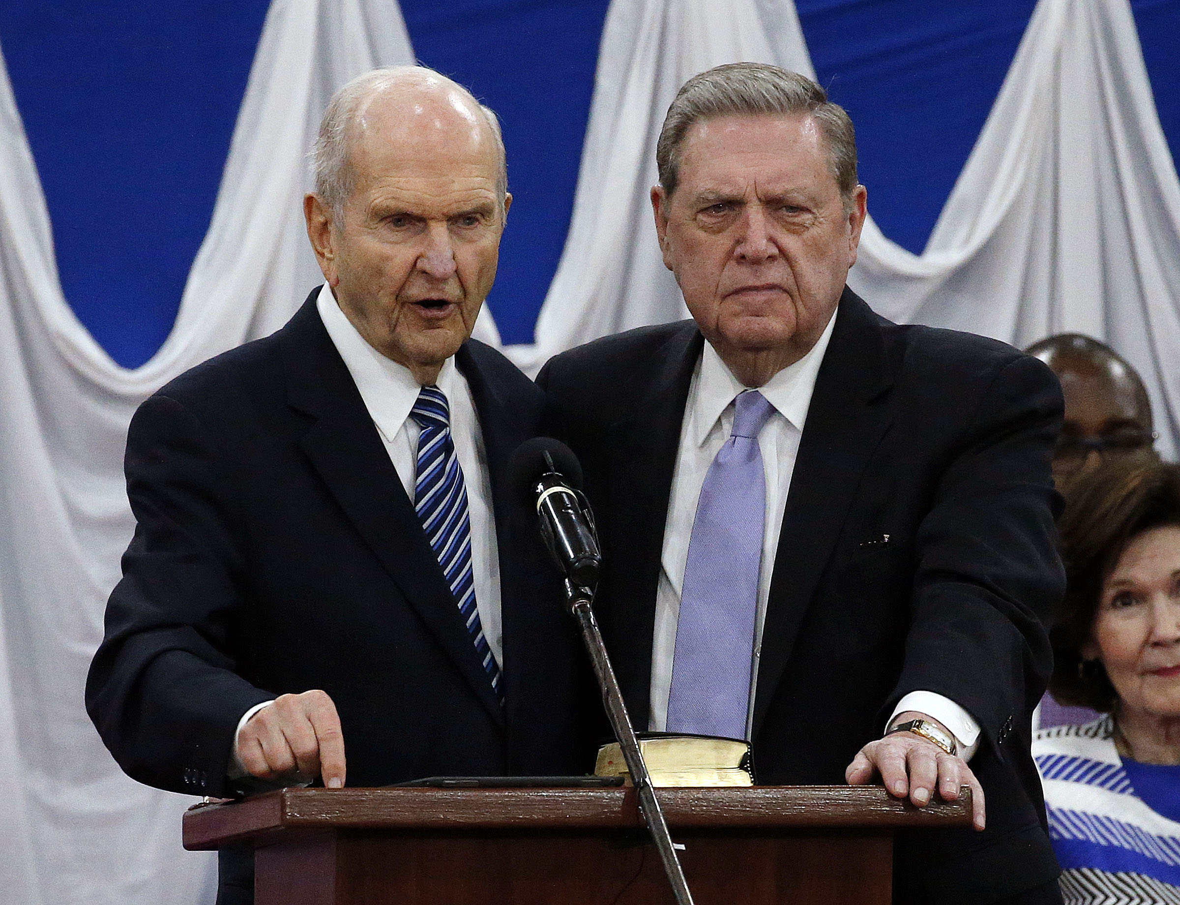 President Russell M. Nelson and Elder Jeffrey R. Holland of The Church of Jesus Christ of Latter-day Saints stand together as President Nelson gives a blessing during a special devotional in Nairobi, Kenya on Monday, April 16, 2018.