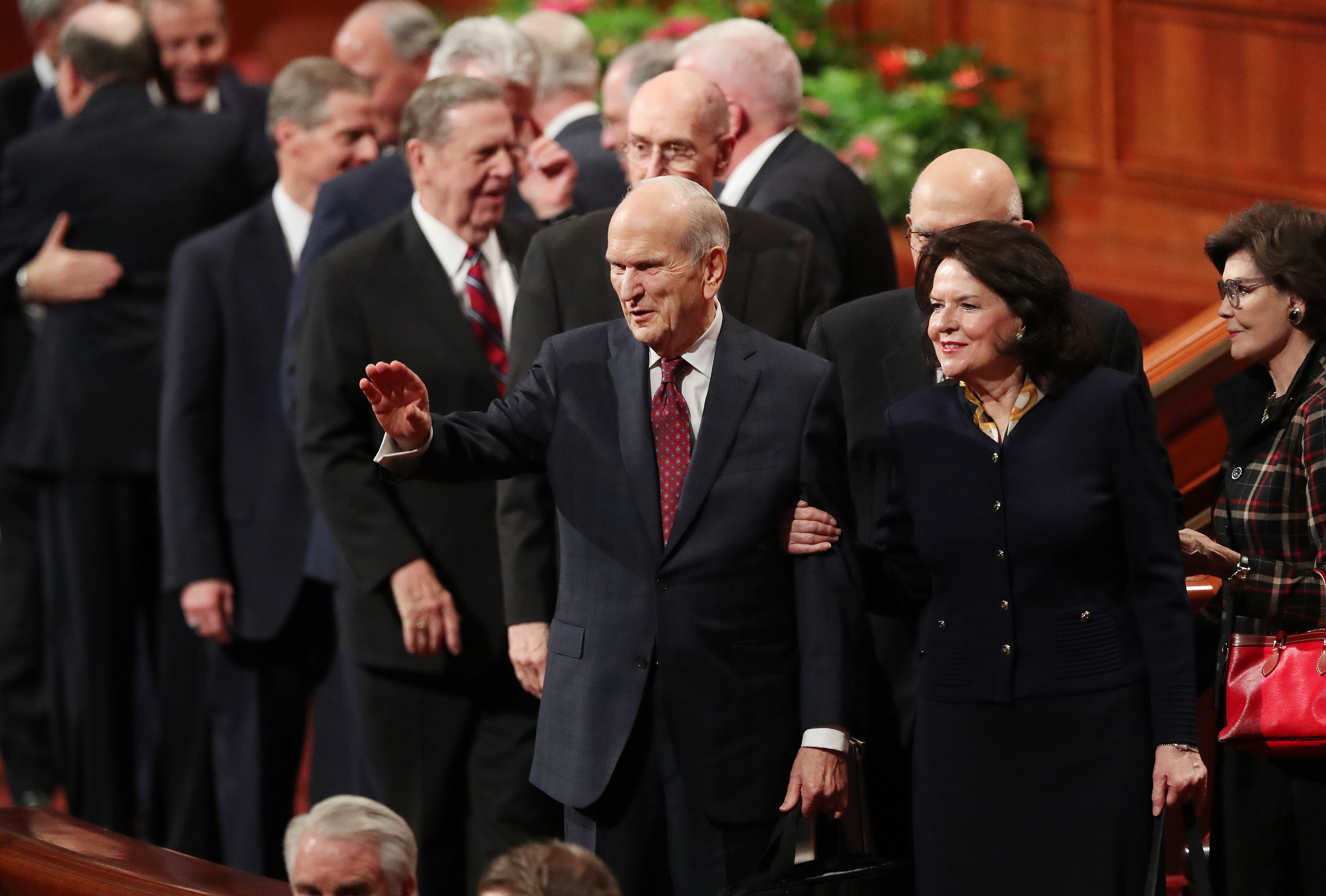 President Russell M. Nelson of The Church of Jesus Christ of Latter-day Saints waves to attendees along with his wife, Sister Wendy Nelson, after the Sunday afternoon session of the 188th Semiannual General Conference of The Church of Jesus Christ of Latter-day Saints in Salt Lake City on Sunday, Oct. 7, 2018.