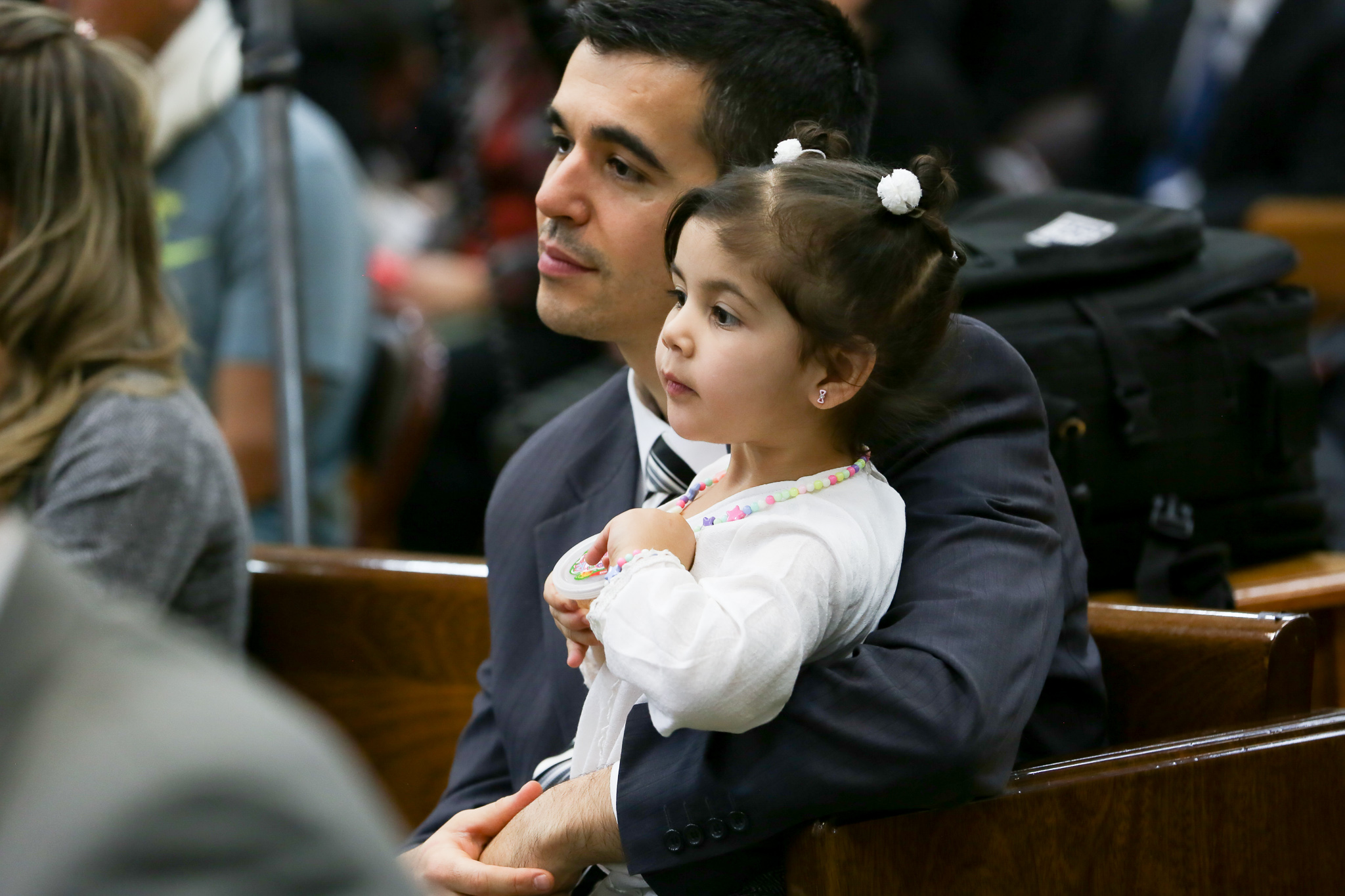 A father and daughter in the Tierra del Fuego Argentina Stake listen in the congregation during a meeting to create the new stake on June 2, 2019.