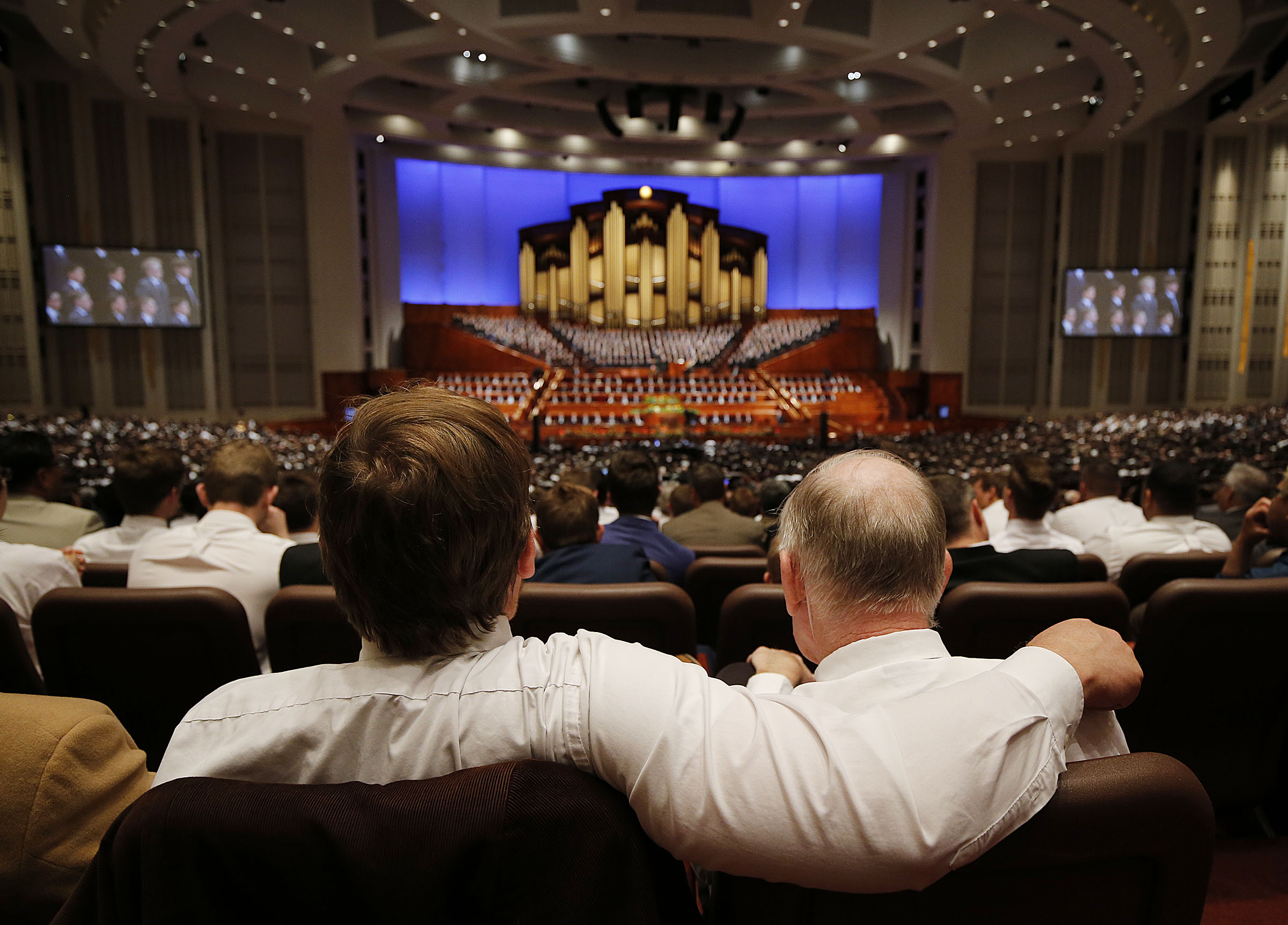 Johnny Walker, left, sits with his father, Andy, during the priesthood session of the 189th Annual General Conference of The Church of Jesus Christ of Latter-day Saints in the Conference Center in Salt Lake City on Saturday, April 6, 2019.