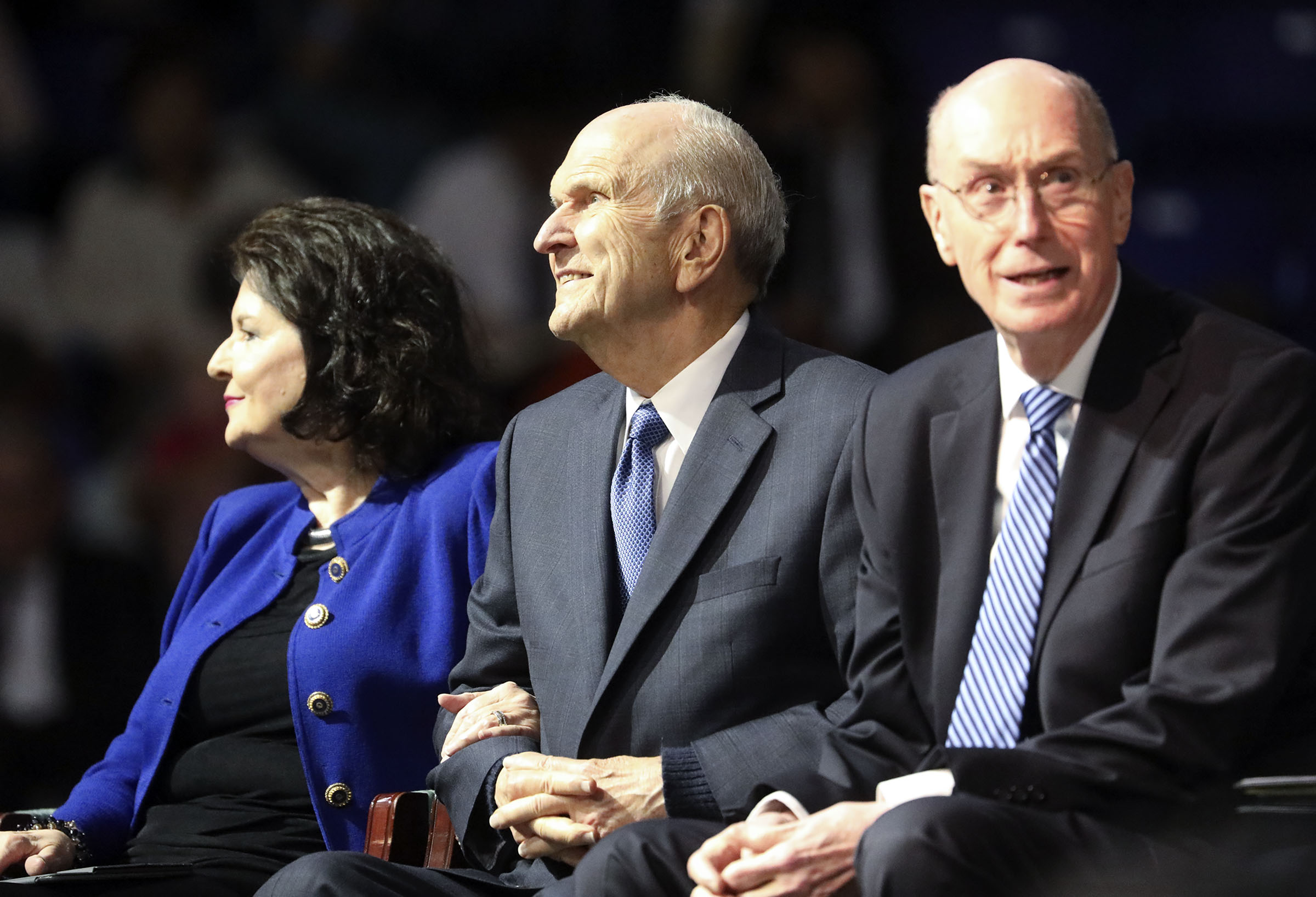 Sister Wendy Nelson, President Russell M. Nelson of The Church of Jesus Christ of Latter-day Saints and President Henry B. Eyring, second counselor in the First Presidency, look at the crowd before speaking at the Langley Events Center in Langley, British Columbia, on Sunday, Sept. 16, 2018.
