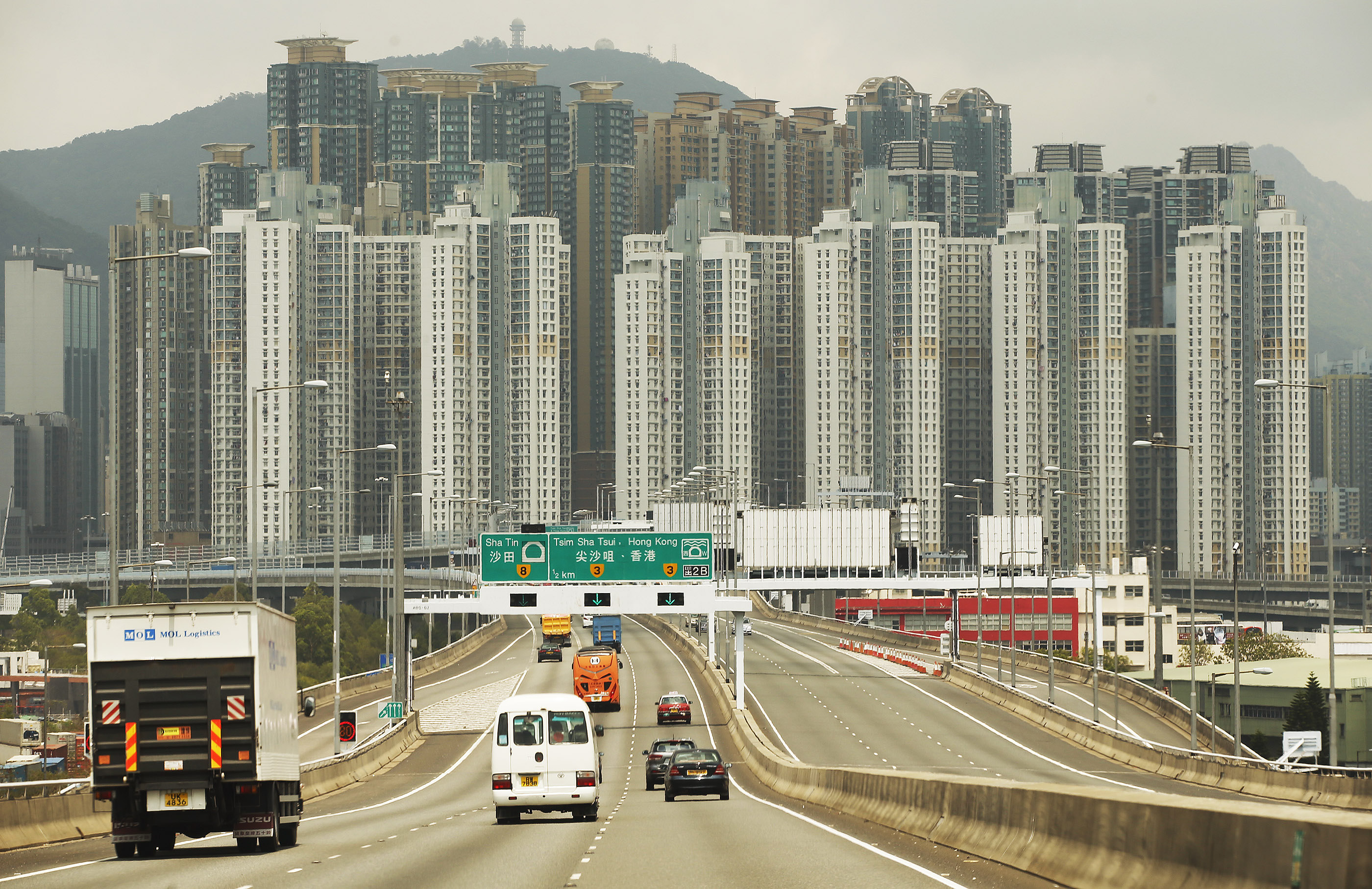 Motorists drive into Hong Kong on Saturday, April 21, 2018.