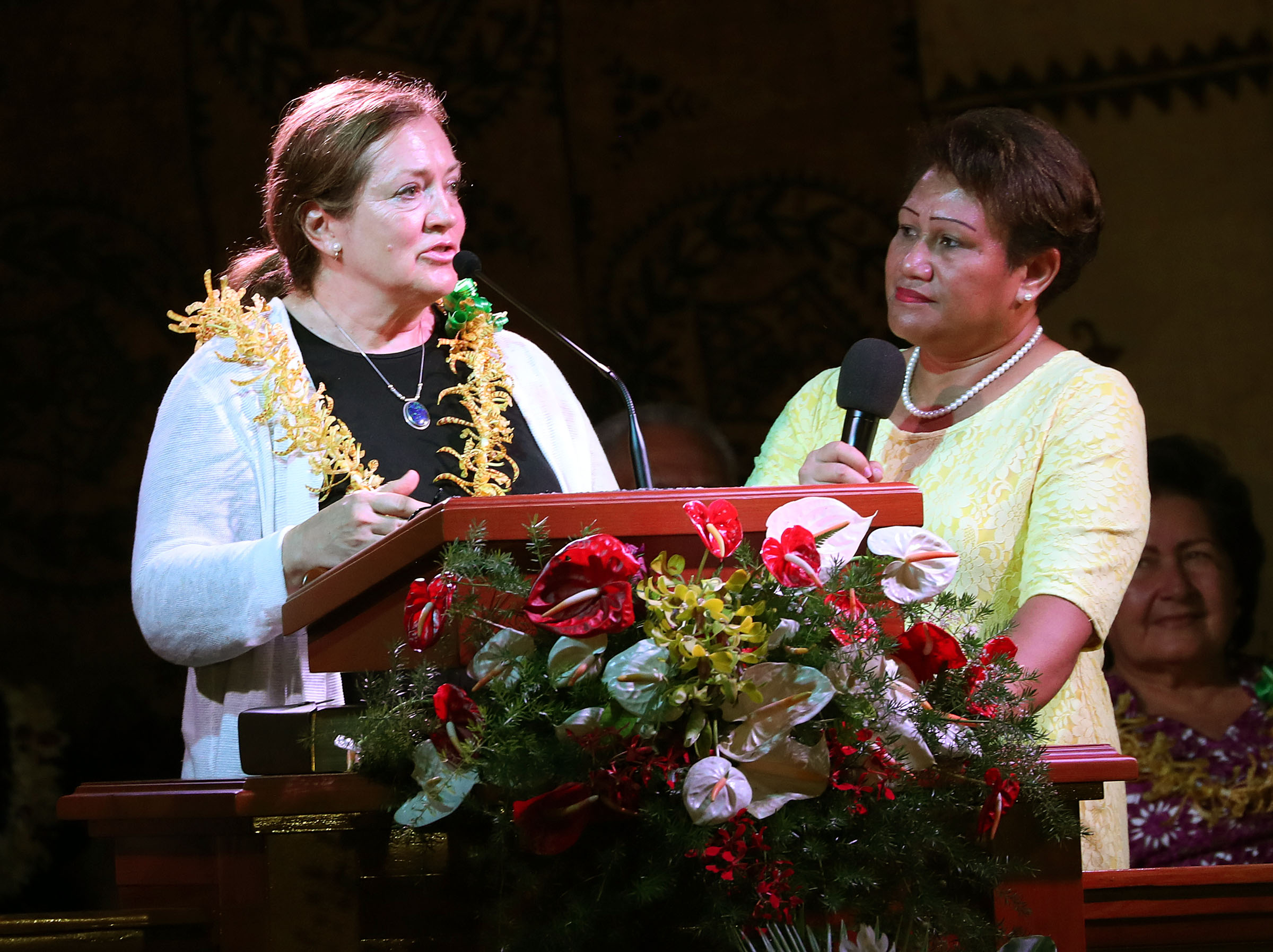 Sister Susan Gong, wife of Elder Gerrit W. Gong of the Quorum of the Twelve Apostles, speaks with an interpreter at right during a devotional with President Russell M. Nelson of The Church of Jesus Christ of Latter-day Saints in Apia, Samoa, on Saturday, May 18, 2019.