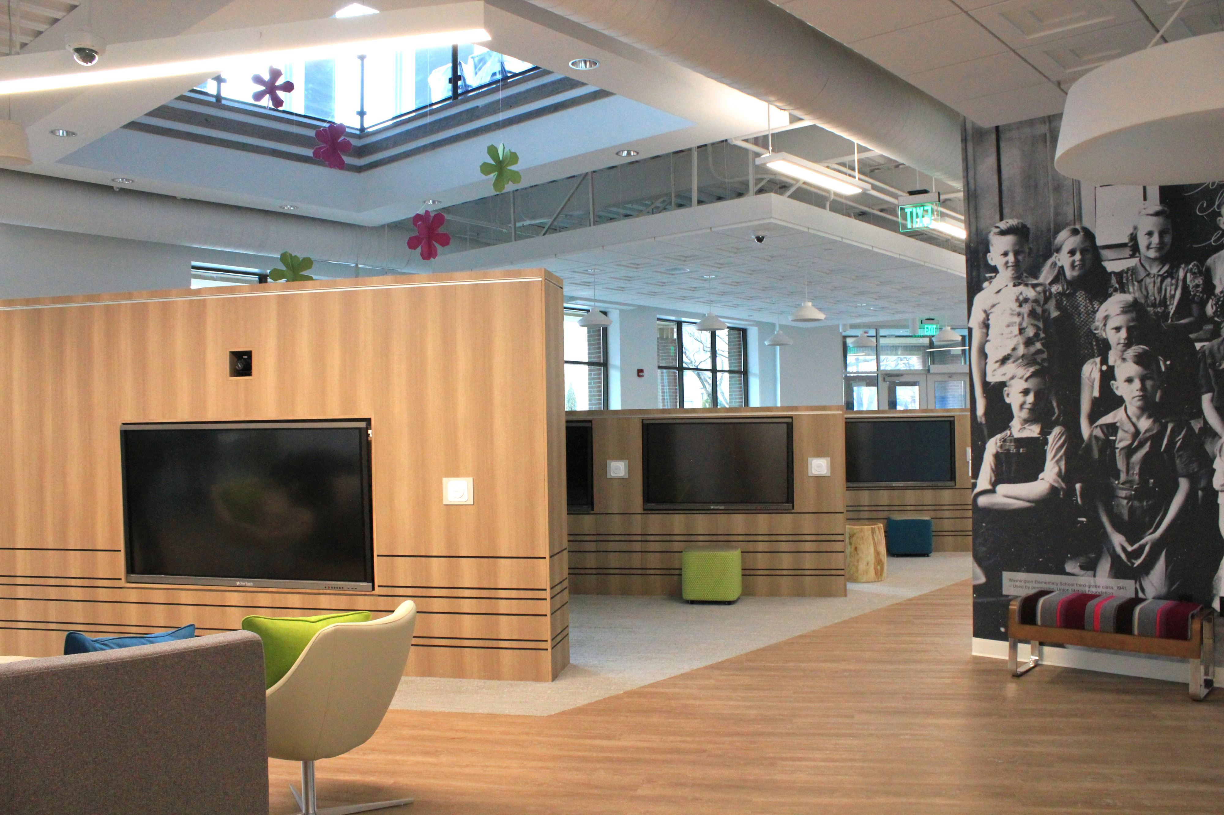 The main floor of the new Ogden Utah FamilySearch Center features life-sized interactive media.