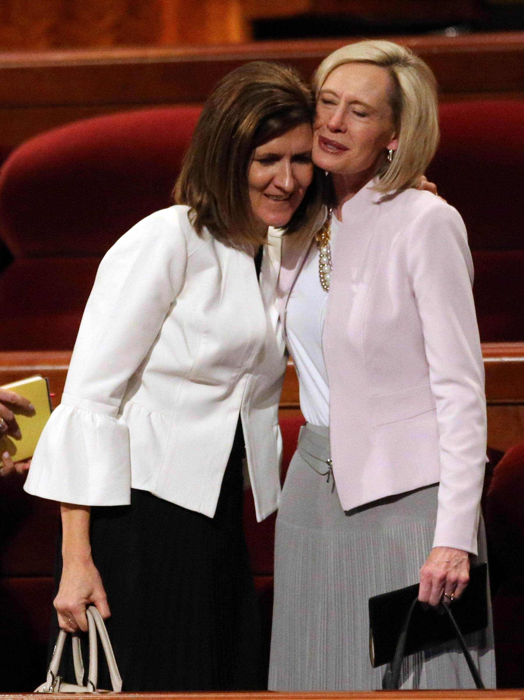 Sister Michelle D. Craig, first counselor in the Young Women general presidency, hugs Sister Bonnie H. Cordon, Young Women general president, after the Sunday afternoon session of the 188th Annual General Conference of The Church of Jesus Christ of Latter-day Saints at the Conference Center in Salt Lake City on Sunday, April 1, 2018.