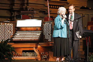 An emotional Wanda Palmer addresses audience at recital. With her is her son, Elder Rick Palmer, a missionary on Temple Square, who was master of ceremonies for the recital.