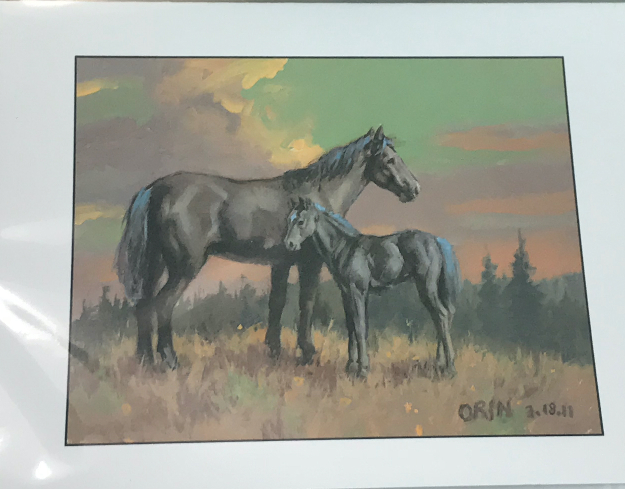 A painting of some horses by Orin Voorheis. More than 20 years after being shot in the head on his mission, Voorheis is living a happy life surrounded by family and friends.