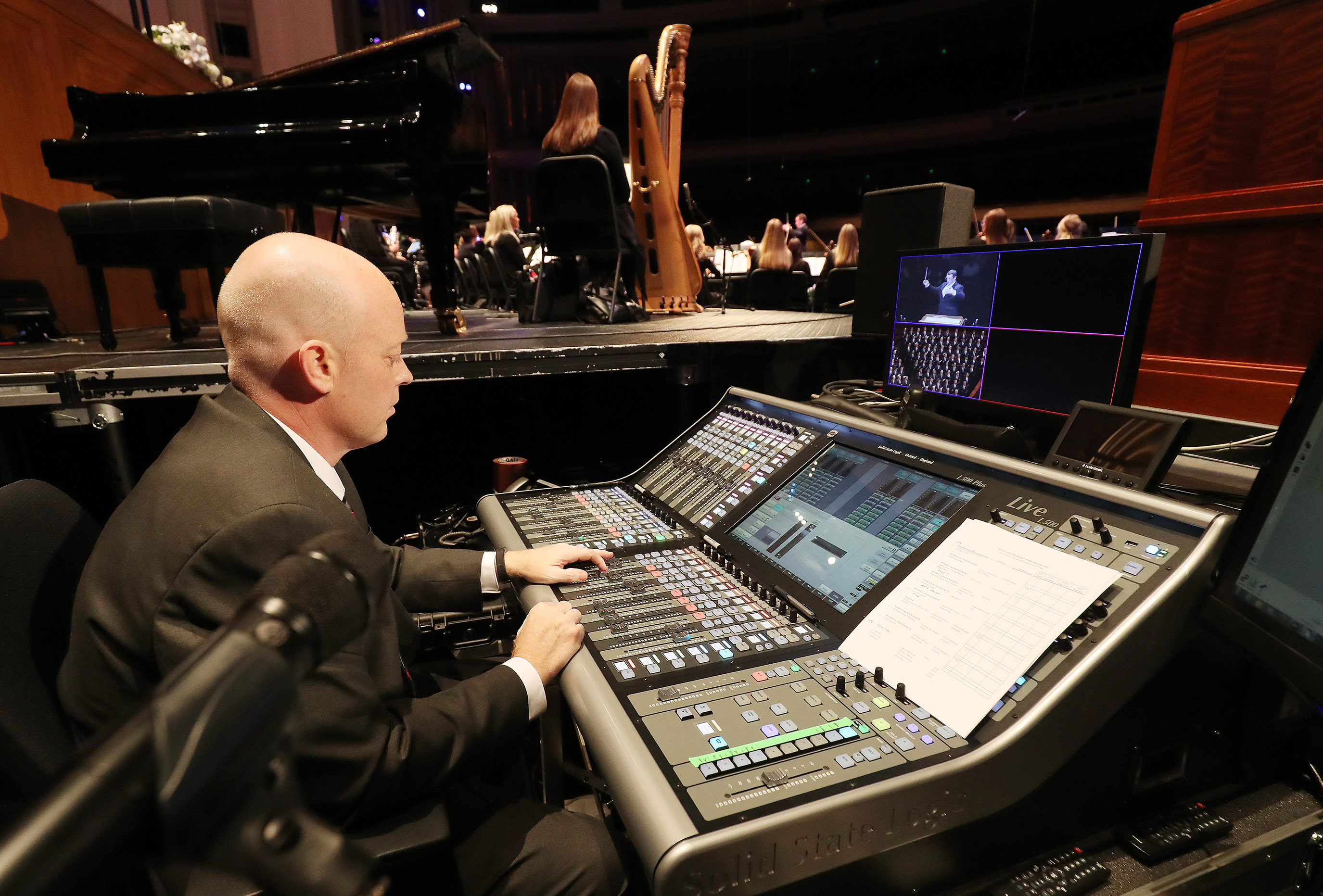 "Sound engineer Joey Russell works as the Tabernacle Choir at Temple Square rehearses for the 90th anniversary of ""Music and the Spoken Word"" in Salt Lake City on Sunday, July 14, 2019."