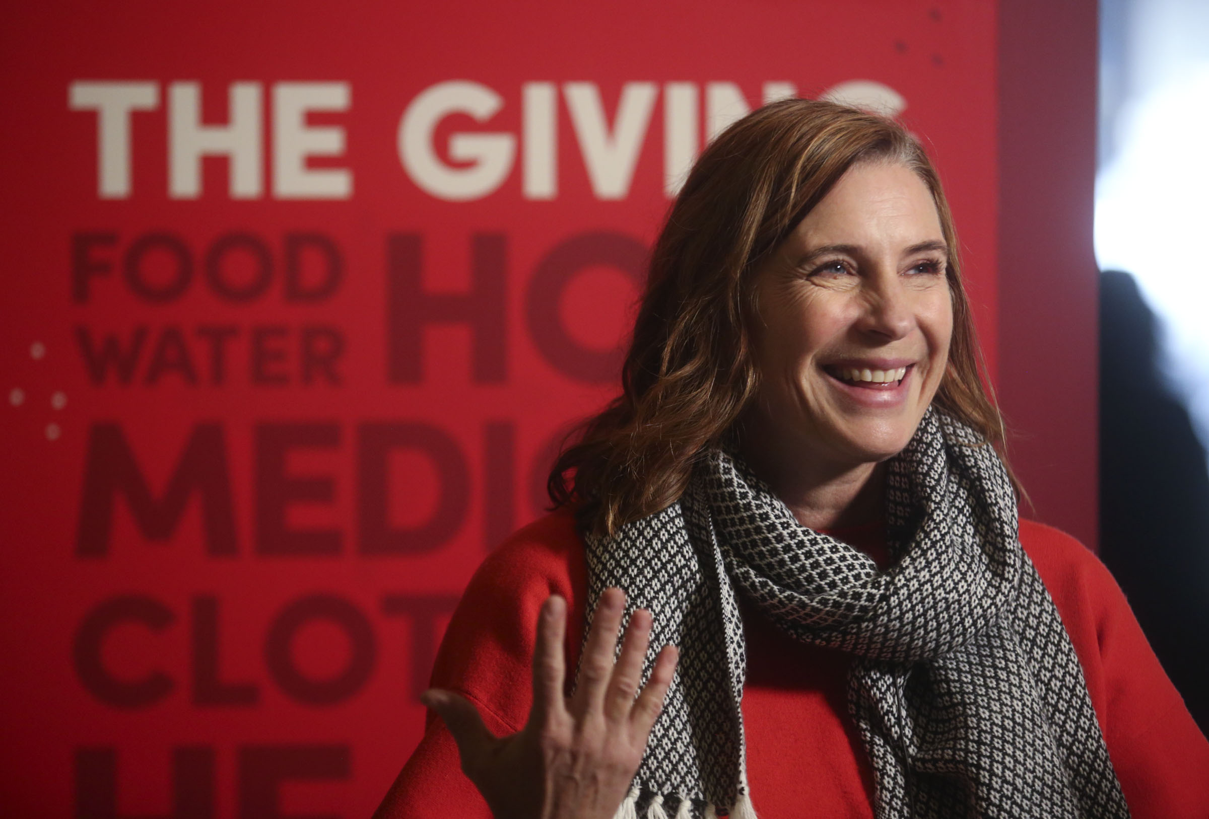 Amy Dott Harmer, executive director of Utah Refugee Connection, talks about the Light the World Giving Machine in the lobby of the Joseph Smith Memorial Building in Salt Lake City on Wednesday, Nov. 28, 2018.